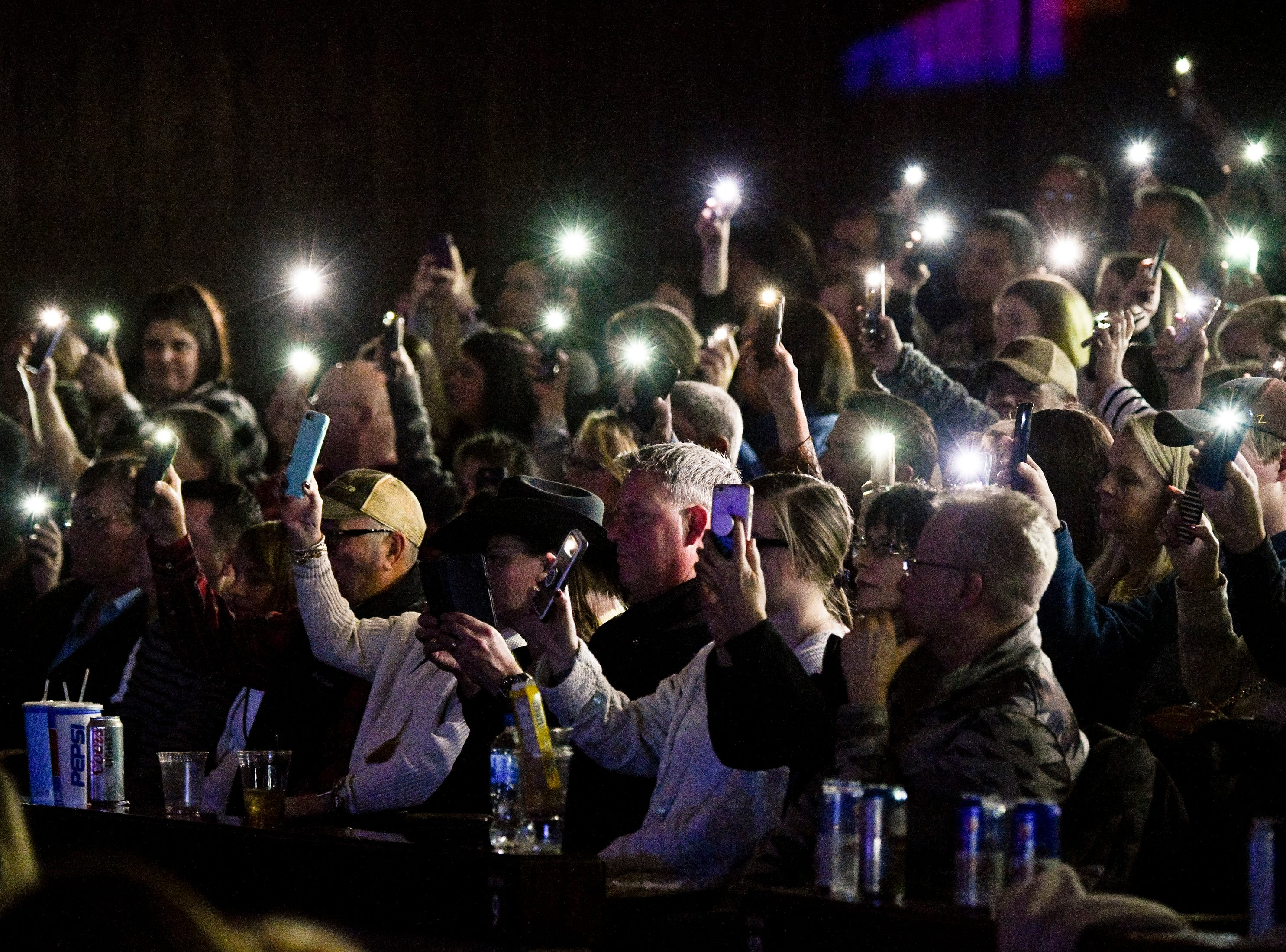 Fans hold up their phones during the C'Ya On The Flipside Benefit Concert at the Grand Ole Opry House in Nashville, Tenn., Wednesday, Jan. 9, 2019.
