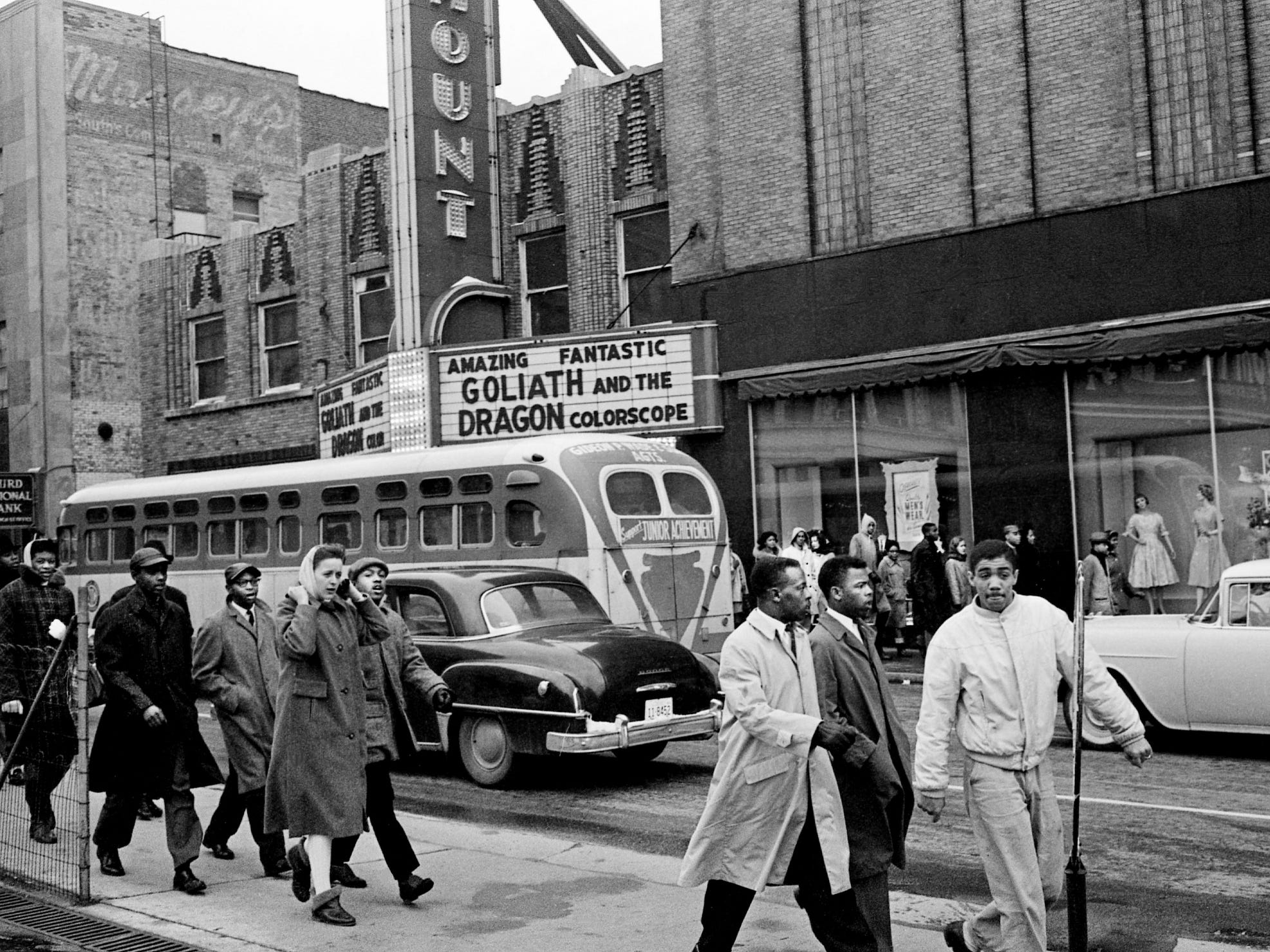 John Lewis, second from right, leads some of the 123 anti-segregation demonstrators past the Paramount theater as they marched through downtown Nashville during a 75-minute stand-in at four Church Street theaters Feb. 24, 1961. The white female student in the group is Salynn McCollum.