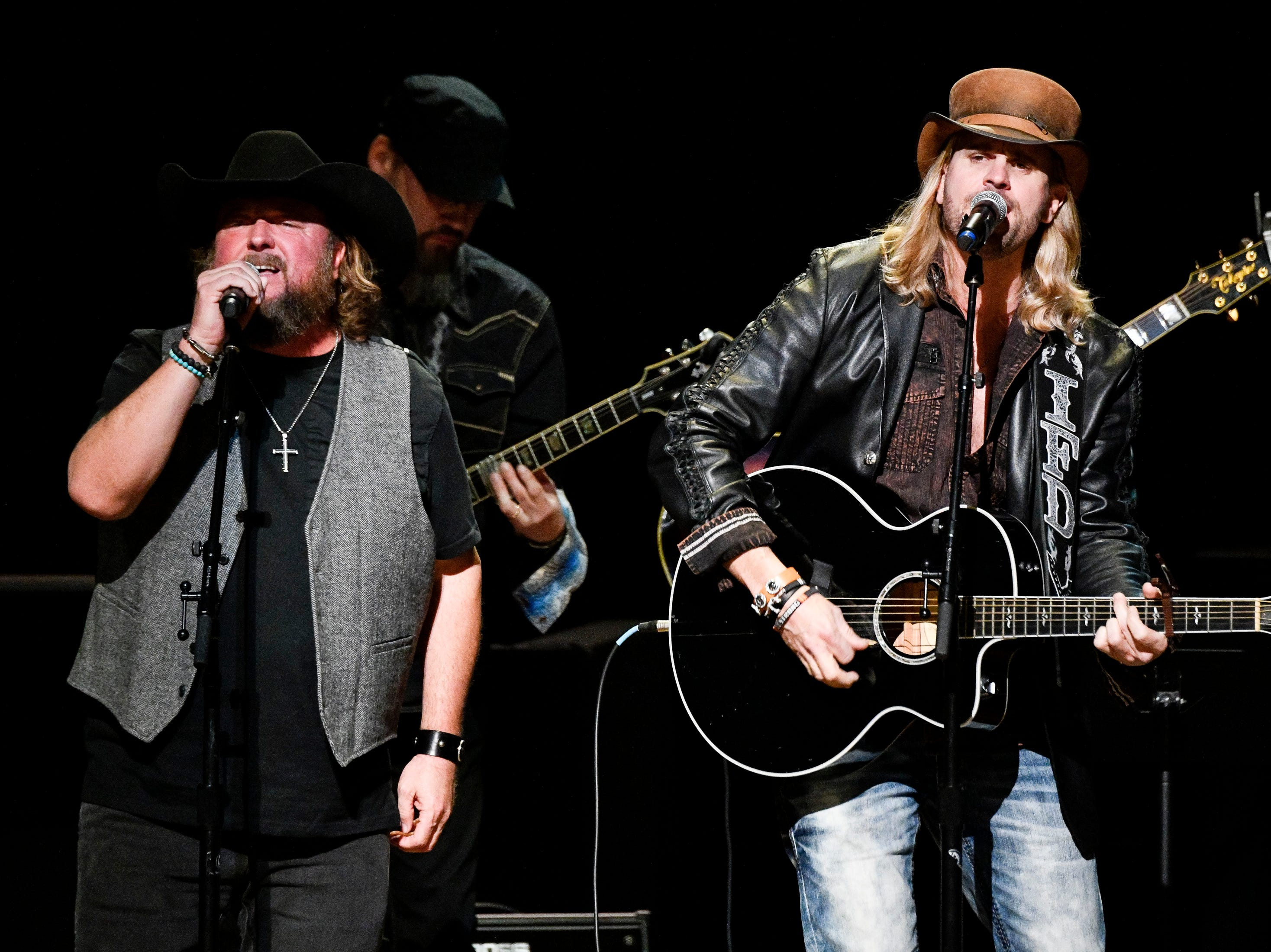 Ira Dean, right, and Colt Ford perform during the C'Ya On The Flipside Benefit Concert at the Grand Ole Opry House in Nashville, Tenn., Wednesday, Jan. 9, 2019.