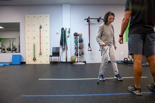 Bella Appelman, who has Parkinson's disease, works on her coordination with trainer Lee Pinkham on Thursday, Jan. 10, 2019, at Naples Personal Training in North Naples.