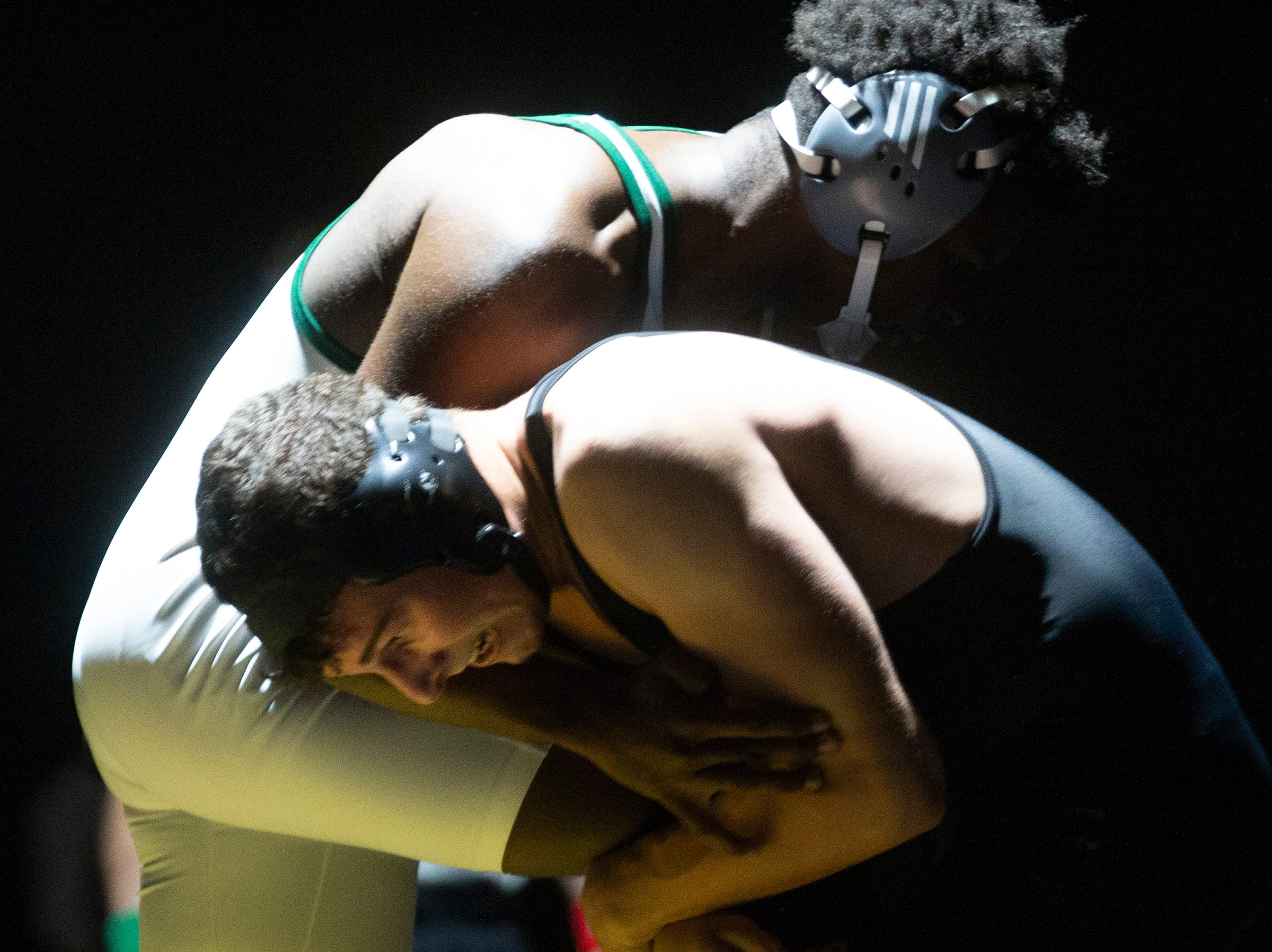 Golden Gates' Tristen Stonebraker and Palmetto Ridge High School's Anthony Mesamours wrestle in the 170-pound weight class at the Collier County Athletic Conference wrestling championship, Wednesday, Jan. 9, 2018, at Naples High School.