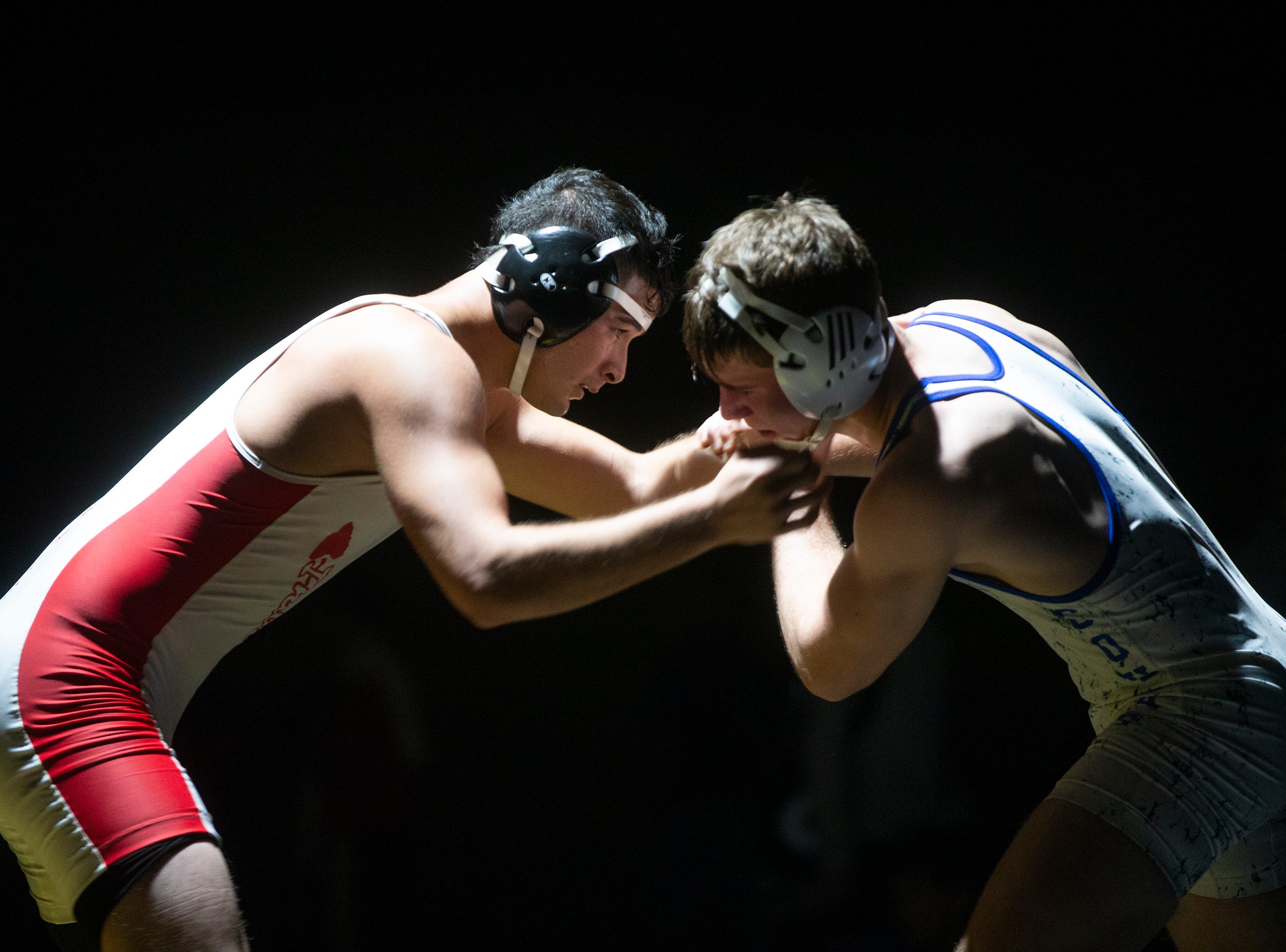 Immokalee High School's Nicolas Turrubiartez wrestles Barron G. Collier High School's Carson Benitez in the 160-pound match up during the Collier County Athletic Conference wrestling championship, Wednesday, Jan. 9, 2018, at Naples High School.