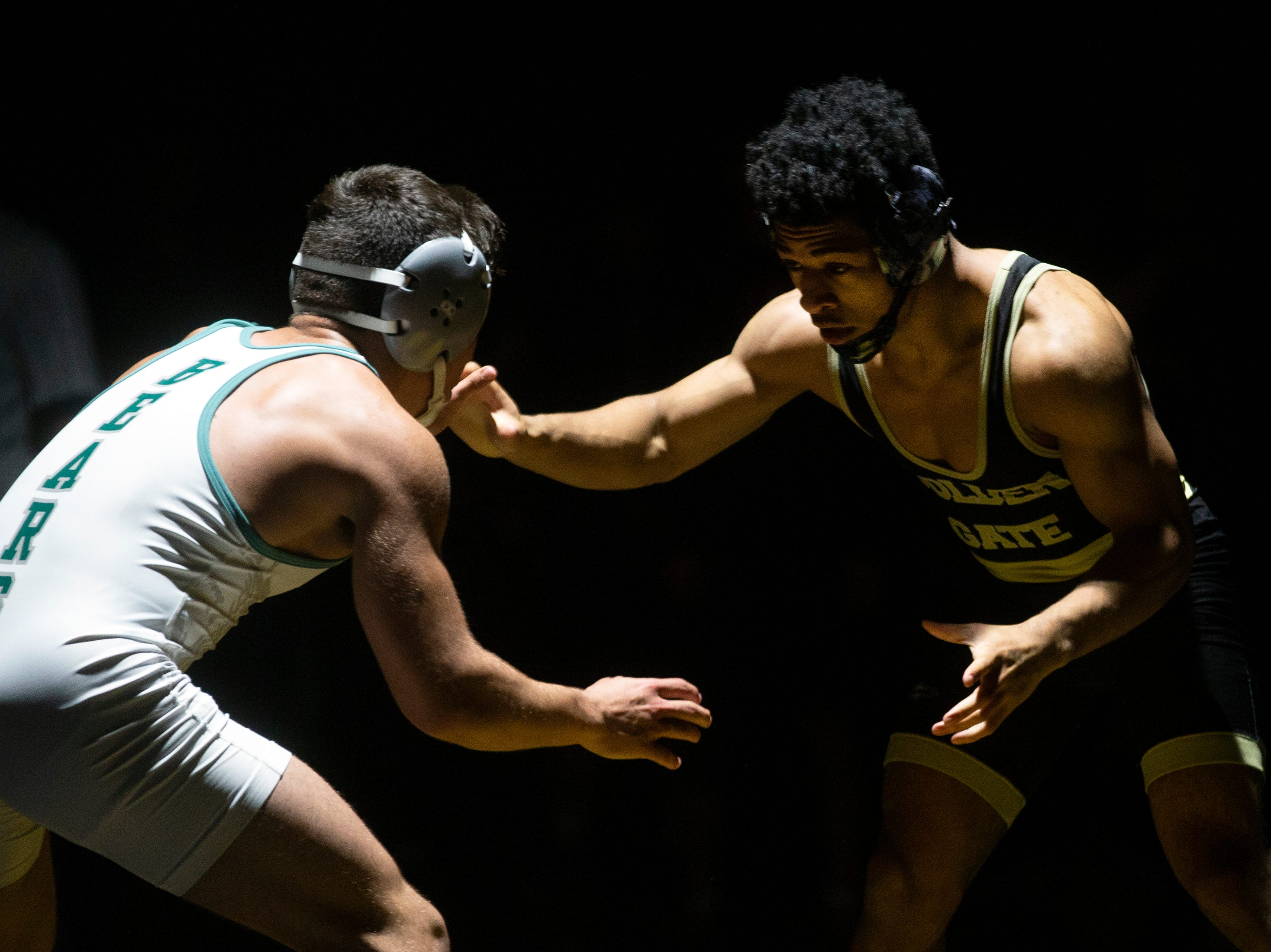 Golden Gate High School's Gerald Roger Palmetto Ridge High School's Adrian Ayala in the 132-pound match up during the Collier County Athletic Conference wrestling championship, Wednesday, Jan. 9, 2018, at Naples High School.