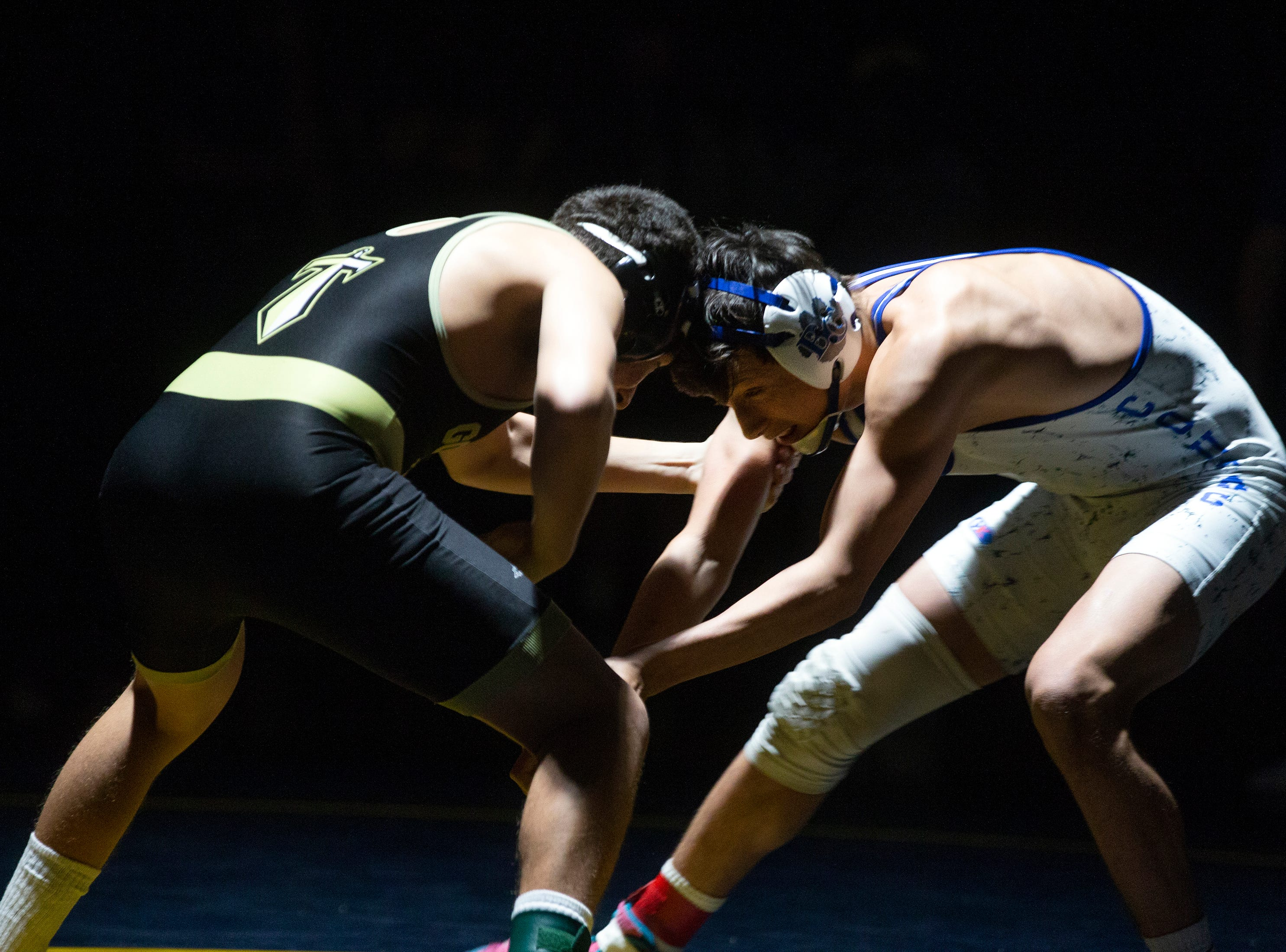 Golden Gate High School's Anthony Valdivia takes on Barron G. Collier High School's Dominic Pappalardo in the 138-pound match up during the Collier County Athletic Conference wrestling championship, Wednesday, Jan. 9, 2018, at Naples High School.