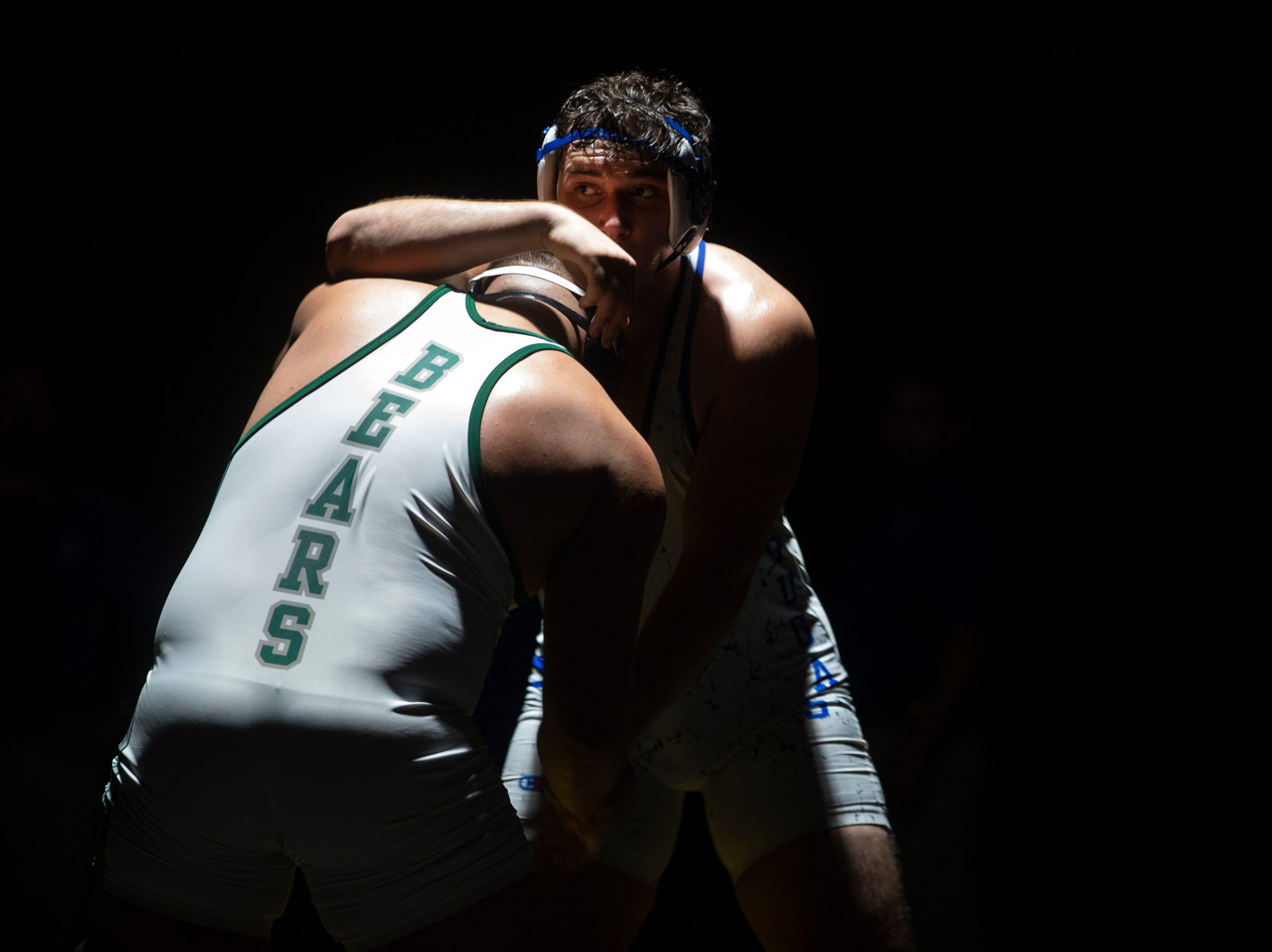 Palmetto Ridge High School's Raymond Peralez and Barron G. Collier High School's Christian Tulbre wrestle in the 285-pound weight class during the Collier County Athletic Conference wrestling championship, Wednesday, Jan. 9, 2018, at Naples High School.