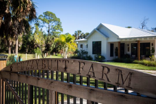 "Michelle Wood had a custom gate made with the name ""Fuzzybutt Farm"" on it. The name of the property, shown Thursday, Jan. 10, 2019, in East Naples, is a nod to the homeowners' many rescued pets."