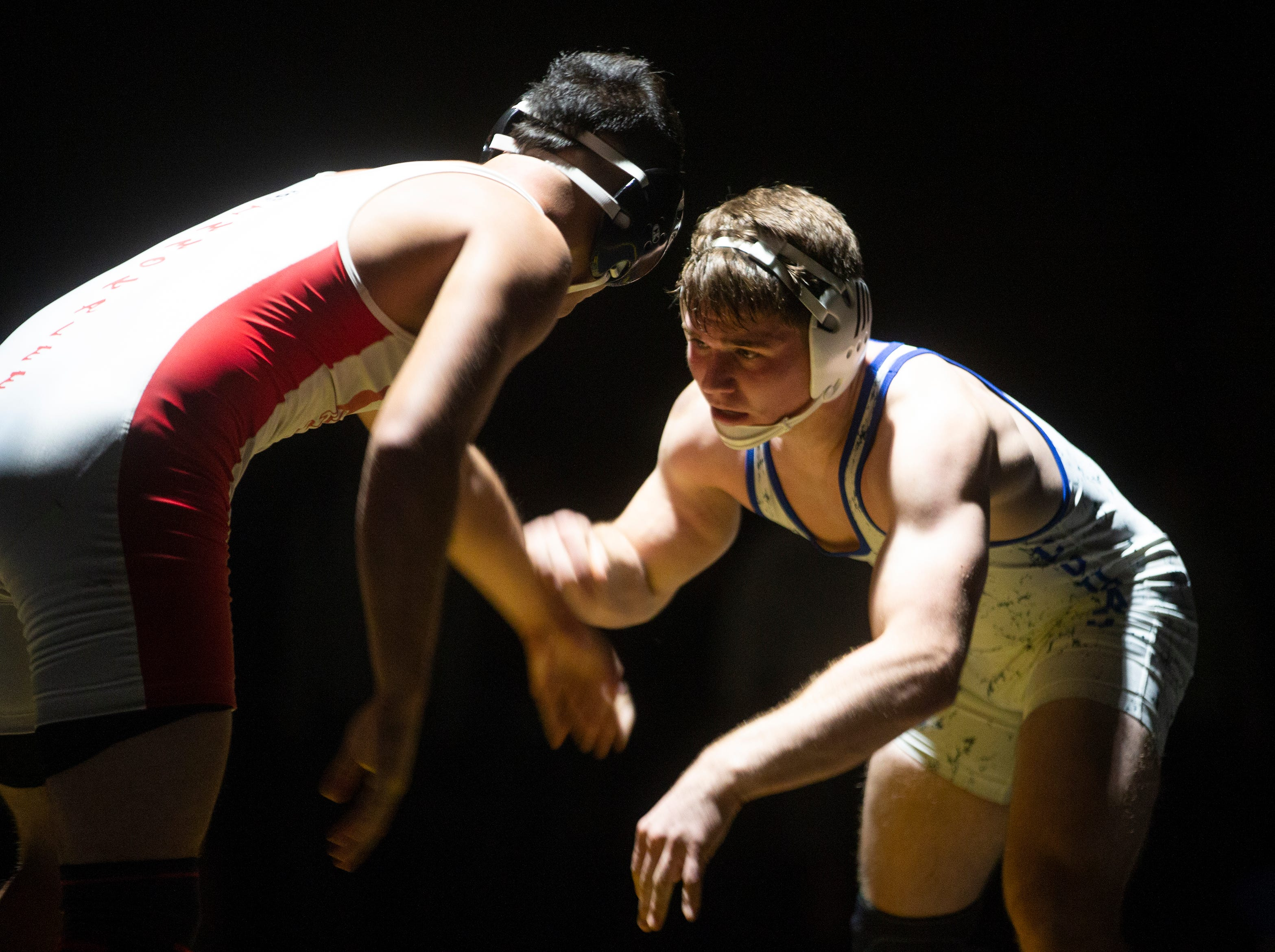 Barron G. Collier High School's Carson Benitez takes on Immokalee High School's Nicolas Turrubiartez in the 160-pound match up during the Collier County Athletic Conference wrestling championship, Wednesday, Jan. 9, 2018, at Naples High School.