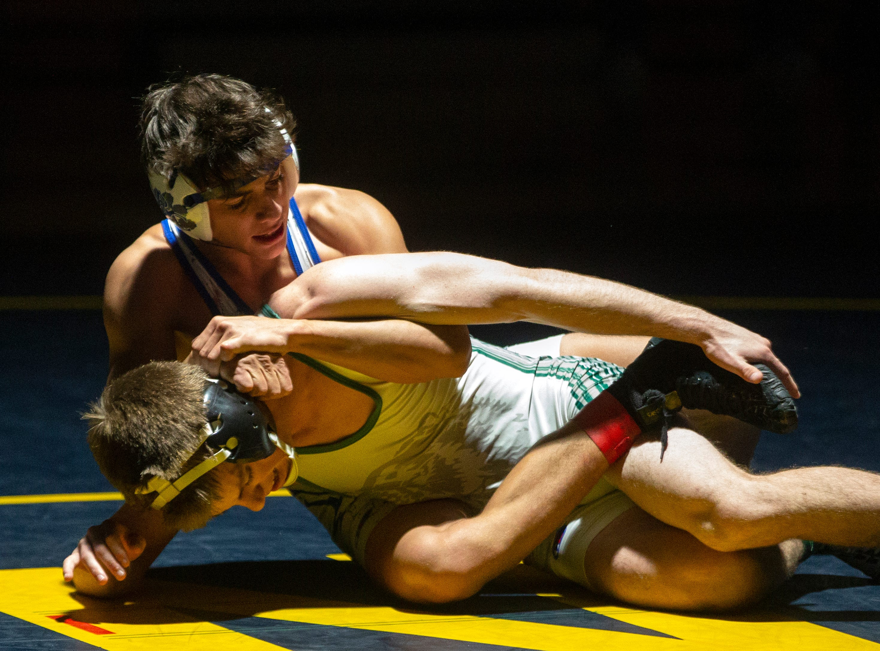 Palmetto Ridge High School's Ben McCallister, top, wrestles Barron G. Collier High School's Roy Chiong in the 120-pound match up during the Collier County Athletic Conference wrestling championship, Wednesday, Jan. 9, 2018, at Naples High School.