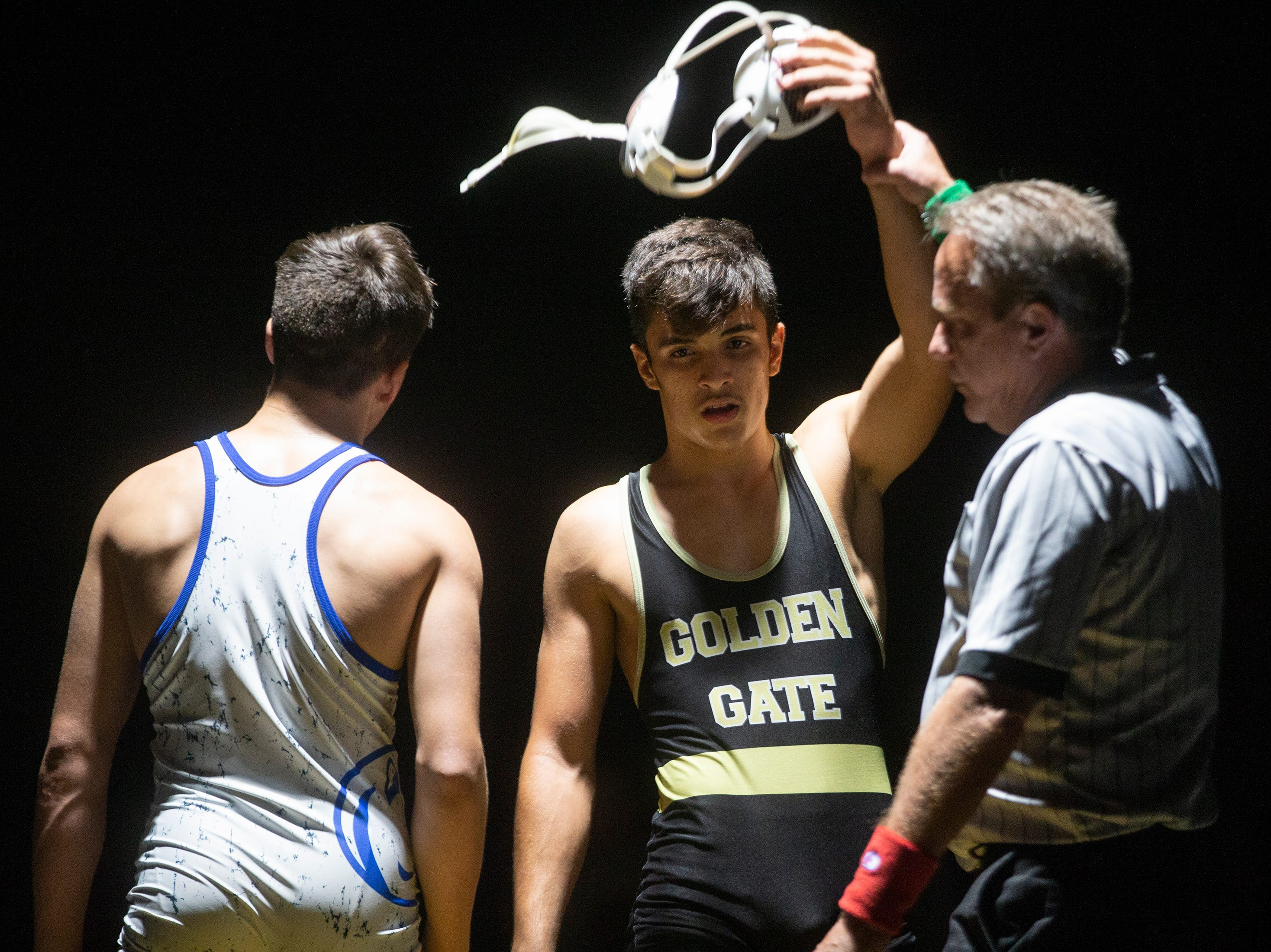 Golden Gate High School's Lais Cardero defeats Barron G. Collier High School's Cory Cannan in the 152-pound weight class during the Collier County Athletic Conference wrestling championship, Wednesday, Jan. 9, 2018, at Naples High School.