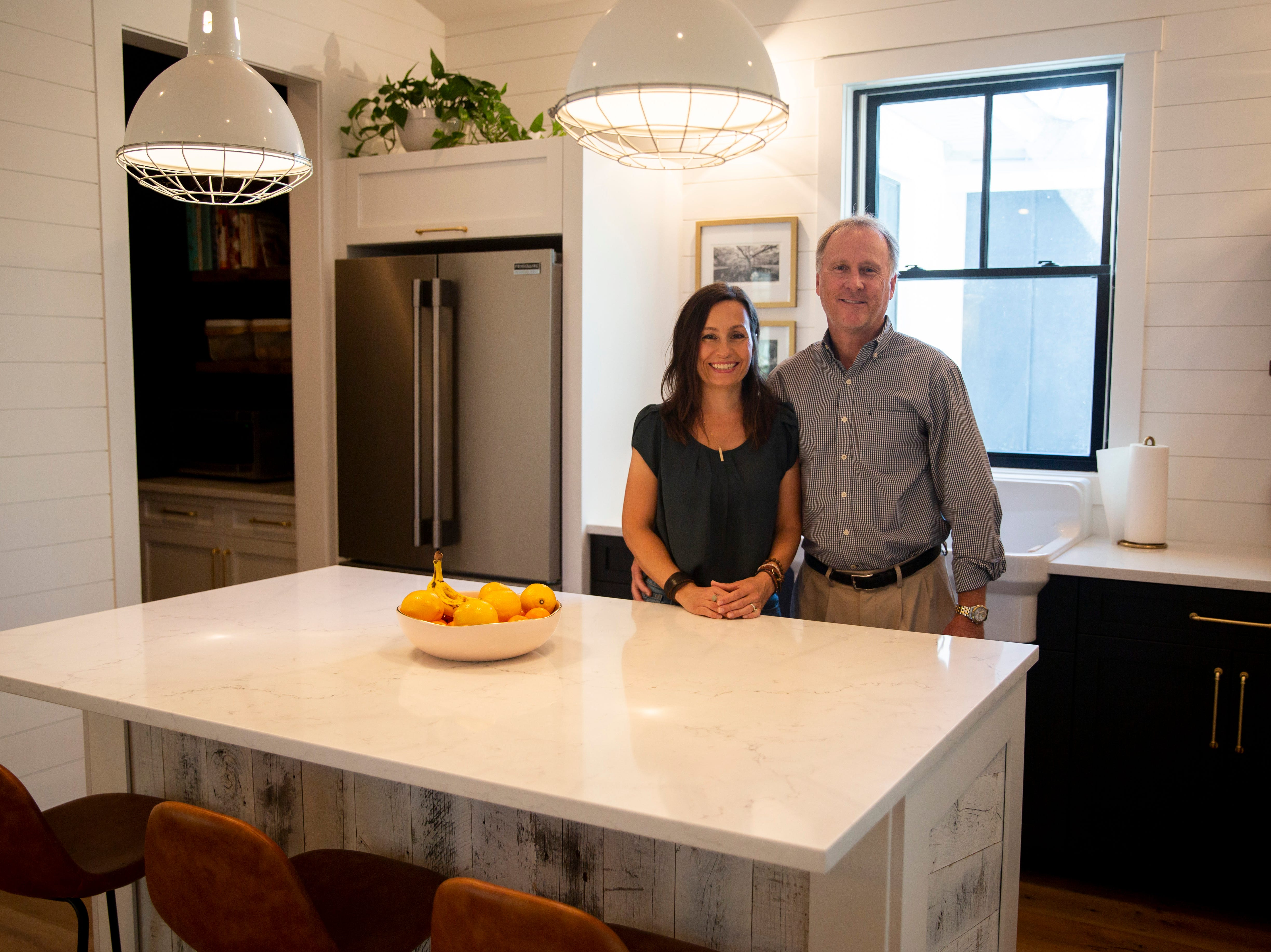 Michelle and Doug Wood pose for a portrait in their kitchen on Thursday, January 10, 2019, in Naples. The couple built their dream home in 2017 and are continuing to work on design projects throughout the house.