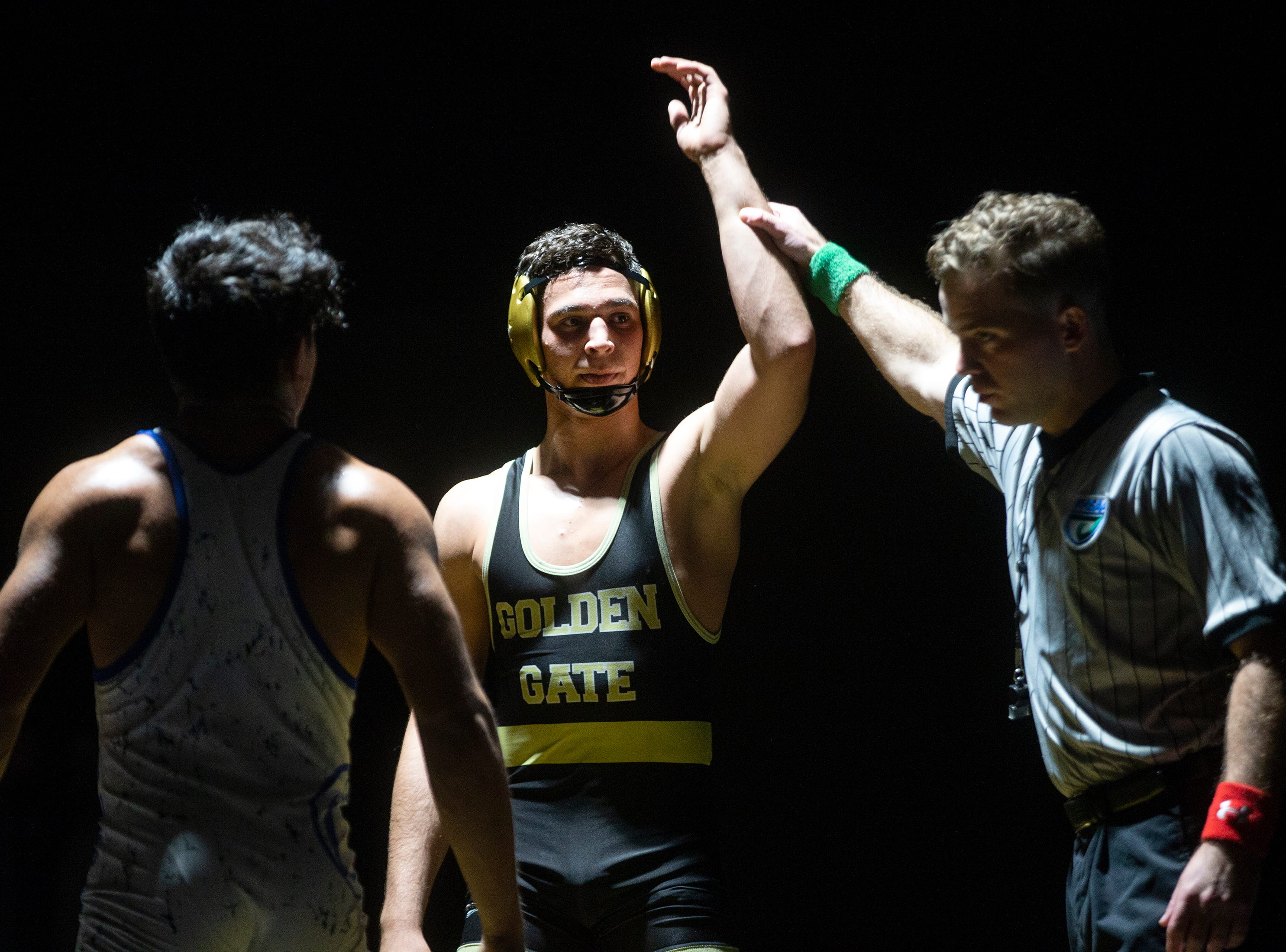 Golden Gate High School's Andy Martinez defeats Barron G. Collier High School's Justin Ugarte in the 145-pound weight class during the Collier County Athletic Conference wrestling championship, Wednesday, Jan. 9, 2018, at Naples High School.