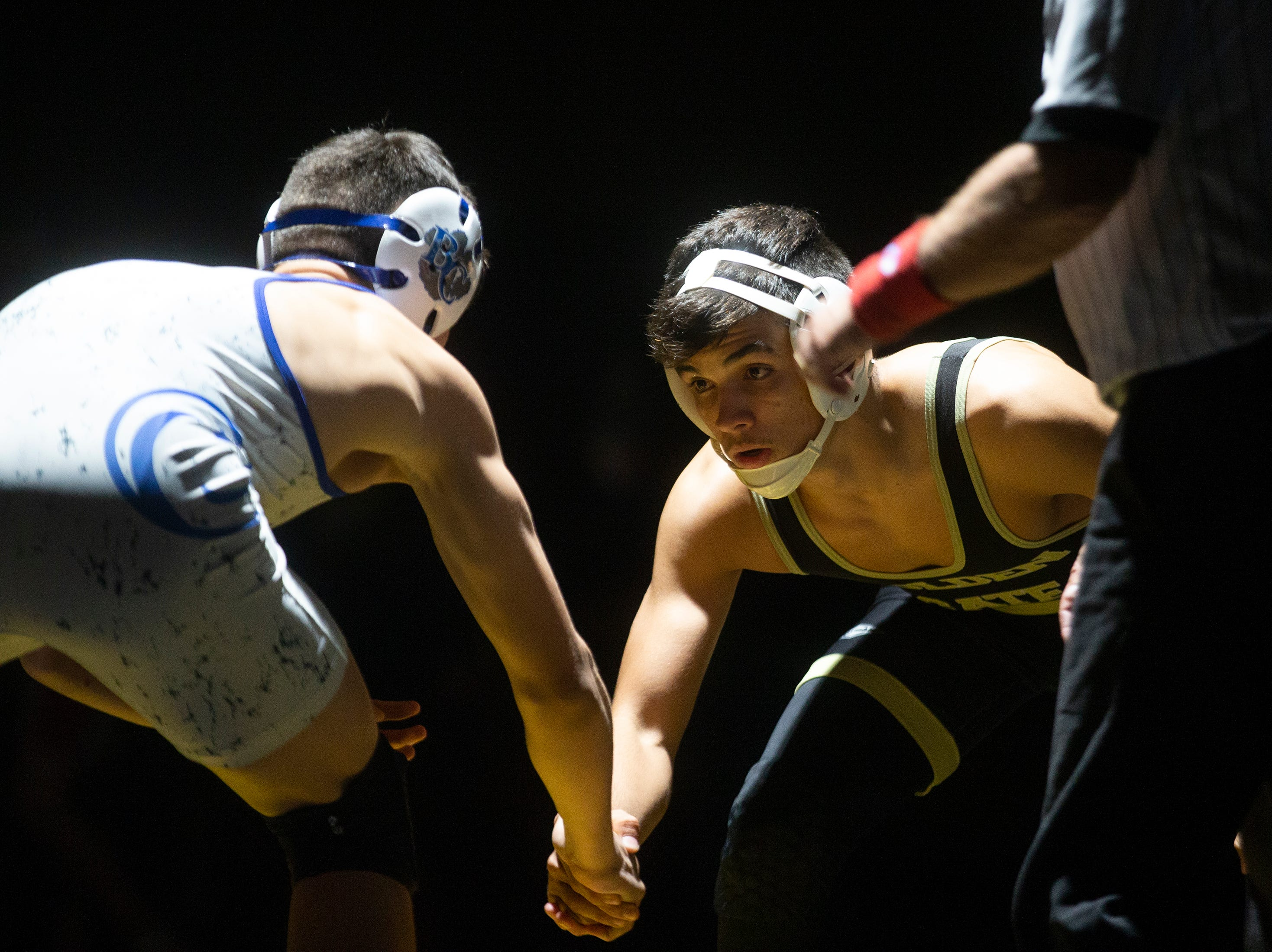 Golden Gate High School's Lais Cardero wrestles Barron G. Collier High School's Cory Cannan in the 152-pound weight class during the Collier County Athletic Conference wrestling championship, Wednesday, Jan. 9, 2018, at Naples High School.