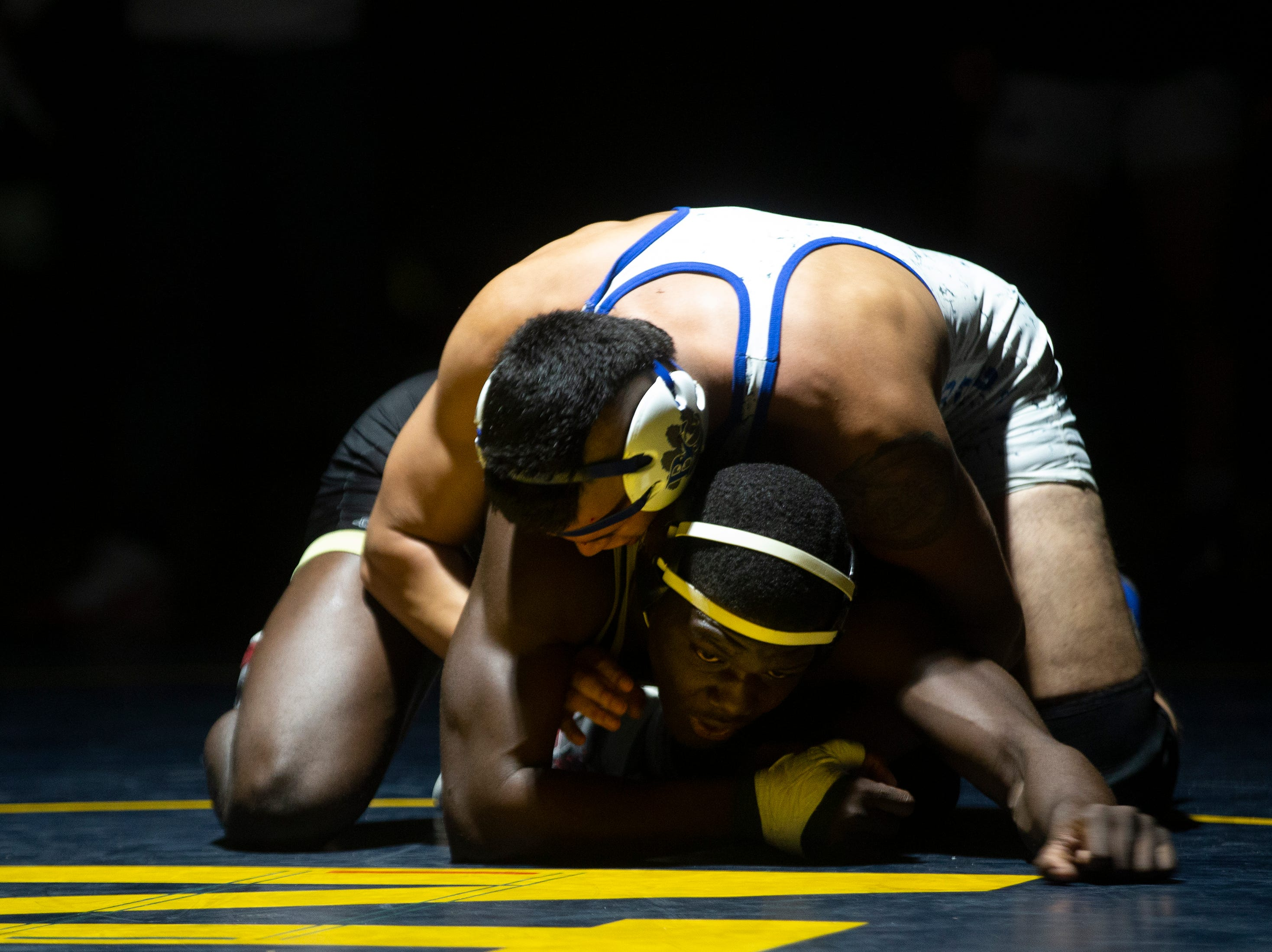 Golden Gate's Kevin Jean Jacques wrestles Barron G. Collier High School's Malcow Casas  in the 195-pound weight class during the Collier County Athletic Conference wrestling championship, Wednesday, Jan. 9, 2018, at Naples High School.