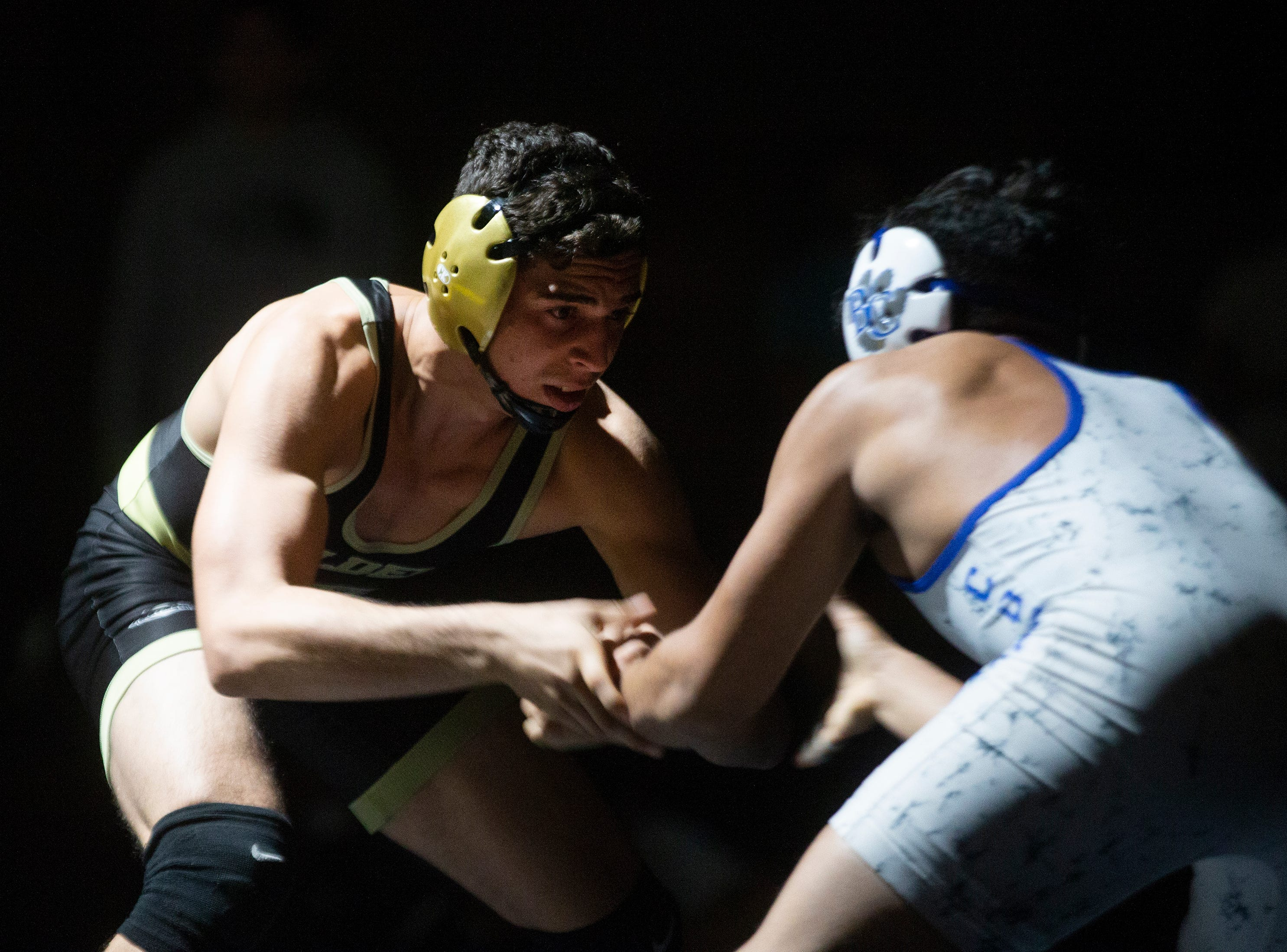 Golden Gate High School's Andy Martinez wrestles Barron G. Collier High School's Justin Ugarte in the 145-pound weight class during the Collier County Athletic Conference wrestling championship, Wednesday, Jan. 9, 2018, at Naples High School.