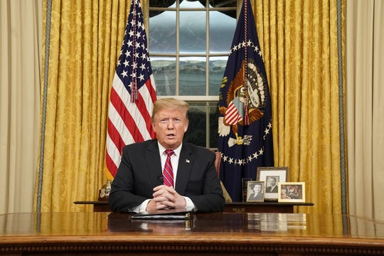 President Donald Trump speaks to the nation in a prime-time address from the Oval Office of the White House on Tuesday,.