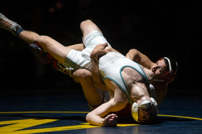 Palmetto Ridge High School's Rickie Montero wrestles Immokalee High School's Gabriel Ramirez in the 126-pound match during the Collier County Athletic Conference wrestling championship, Wednesday, Jan. 9, 2018, at Naples High School.