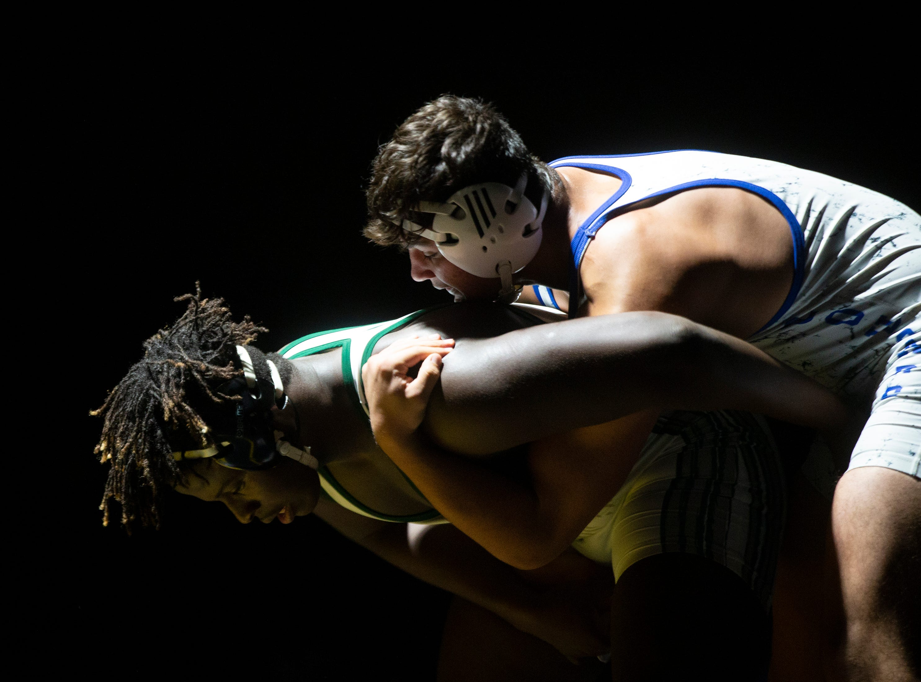 Palmetto Ridge High School's Trilyon Fils-Aime wrestles Barron G. Collier High School's Sebastian Torres in the 220-pound match up during the Collier County Athletic Conference wrestling championship, Wednesday, Jan. 9, 2018, at Naples High School.