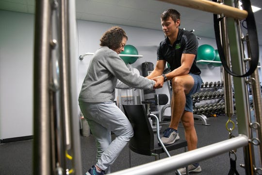 Lee Pinkham, an exercise specialist with Naples Personal Training, works with Bella Appelman, 72, who has Parkinson's disease, on Thursday, Jan. 10, 2019, in North Naples.