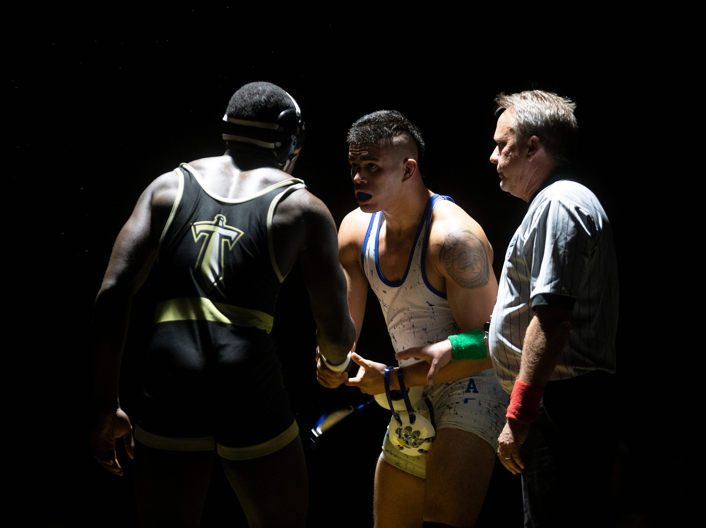 Barron G. Collier High School's Malcow Casas shakes hands with Golden Gate's Kevin Jean Jacques after winning his match in the 195-pound weight class at the Collier County Athletic Conference wrestling championship, Wednesday, Jan. 9, 2018, at Naples High School.