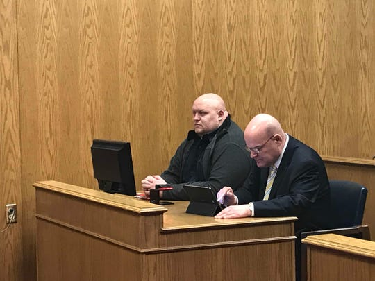 DeWayne Johnson (left) appears at a sentencing hearing in Licking County Common Pleas Court alongside his attorney Todd Barstow (right) on Thursday, Jan. 10, 2019.