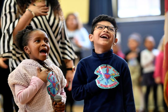 Preschoolers Charly, left, and Roone recite the pledge of allegiance to begin the ribbon cutting for the new full day preschool program at Bryant School on Thursday, Jan. 10, 2019, in Teaneck.