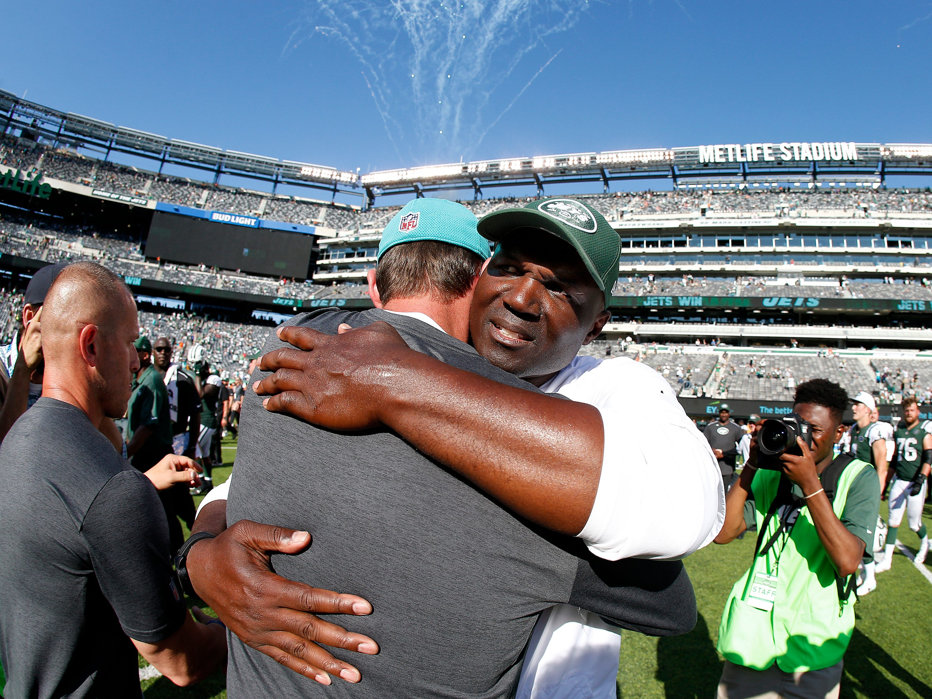 EAST RUTHERFORD, NJ - Head coach Adam Gase of the Miami Dolphins and head coach Todd Bowles of the New York Jets meet at midfield after an NFL game at MetLife Stadium on September 24, 2017 in East Rutherford, New Jersey. The New York Jets defeated the Miami Dolphins 20-6.