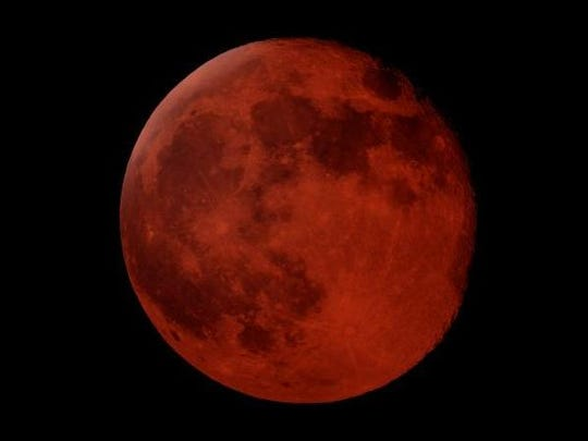 "A total lunar eclipse, dubbed a super blood wolf moon, will happen Jan. 20. Lunar eclipses cause the moon to turn a reddish color, thus a ""blood moon."""