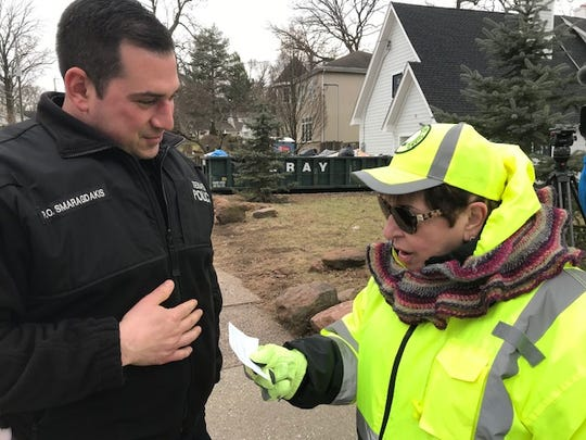 Officer Louis Smaragdakis with Kathy Iannantuano