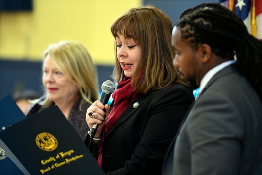 Bergen County freeholder chairwoman Germaine Ortiz, center, reads a resolution for Superintendent of Teaneck Public Schools Christopher C. Irving, far right, during a ribbon cutting at the Bryant School for their new full day preschool program on Thursday, Jan. 10, 2019, in Teaneck.