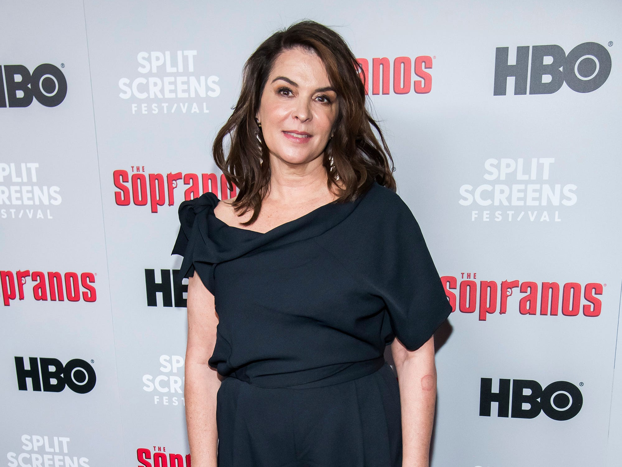 "Annabella Sciorra, who played Gloria Trillo on the show, attends HBO's ""The Sopranos"" 20th anniversary at the SVA Theatre on Wednesday, Jan. 9, 2019, in New York. (Photo by Charles Sykes/Invision/AP)"