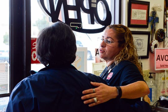 Gina Ortega, who owns La Fiesta Bakery with her husband Ray, hugs a customer at the bakery on Jan. 10, 2019. The bakery will be closing because of declining sales caused by the Valley Drive construction project.