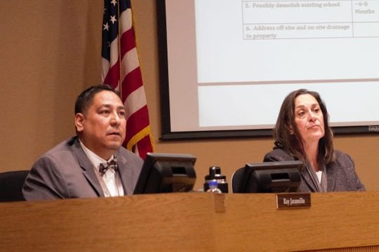From left, Las Cruces board of education members Ray Jaramillo and Terrie Dallman discuss options concerning Columbia Elementary School, which has been closed since September due to severe mold, at a work session on Jan. 8, 2019.