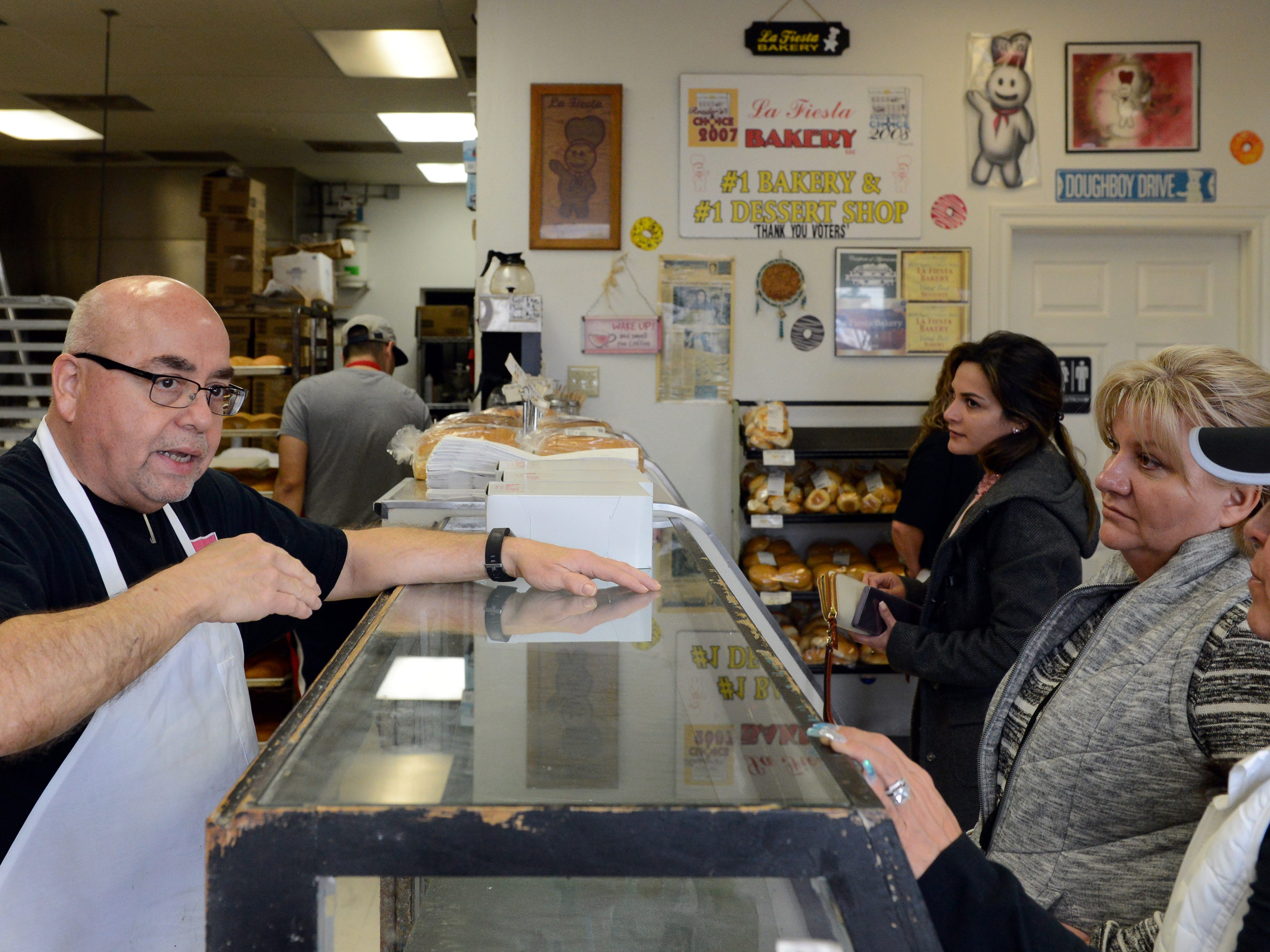 Ray Ortega, who owns La Fiesta Bakery with his wife Gina, speaks to Donna Cyp, right, and Jackie Jarisch at the bakery on Jan. 10, 2019. The bakery will be closing because of declining sales caused by the Valley Drive construction project.