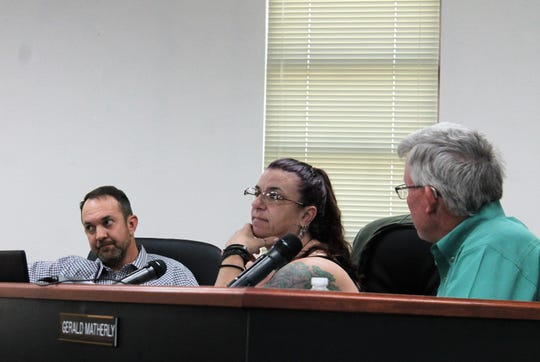 From left Otero County Commissioner Couy Griffin, Otero County Commission Chairwoman Lori Bies and Otero County Commissioner Gerald Matherly discuss the commission's reorganization at Thursday's meeting.