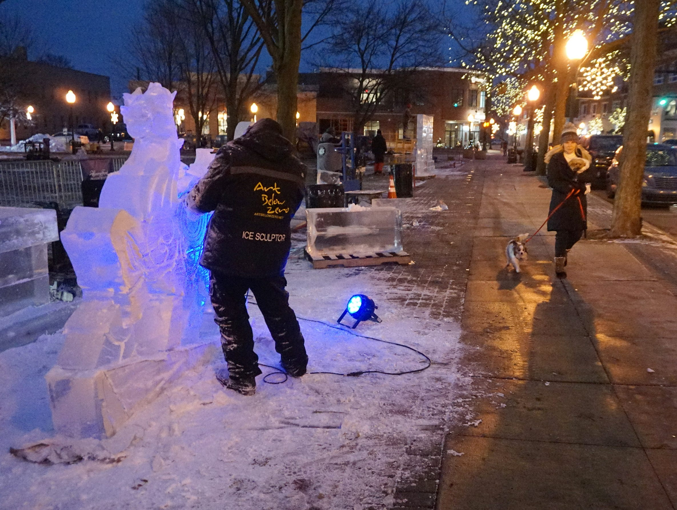 Max Zuleta works on the main feature from elegant Ice Wednesday evening in Kellogg Park where the Plymouth Ice Festival takes place Jan. 11-13.