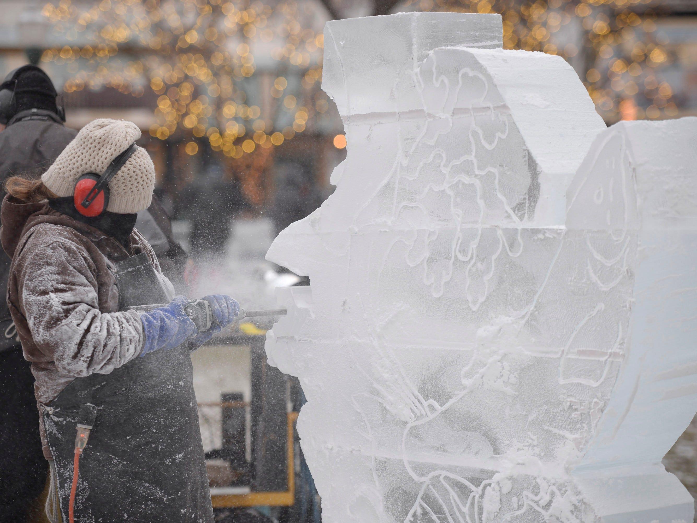 Lauren Klapar carves ice blocks on Jan. 9 preparing for the Plymouth Ice Festival that runs Jan. 11-13.