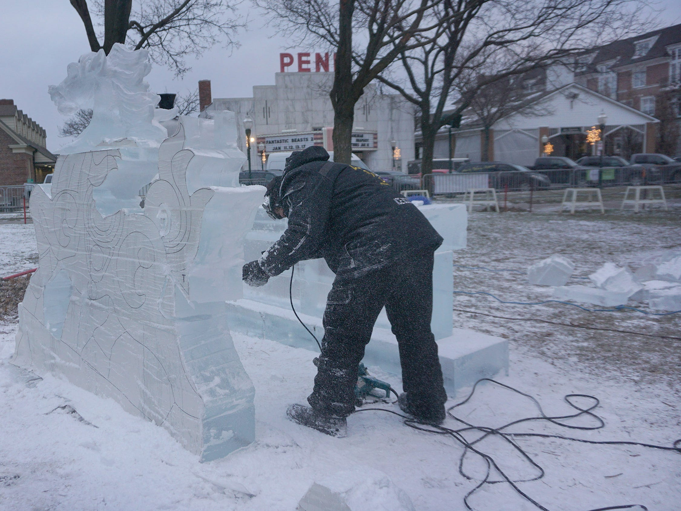 Max Zuleta works on the main piece by Elegant Ice Creations in Kellogg Park for the Plymouth Ice Festival that runs Jan. 11-13.