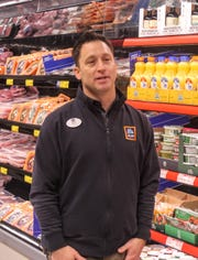 Ben Mulford, store manager, gives a tour to city officials Thursday morning.