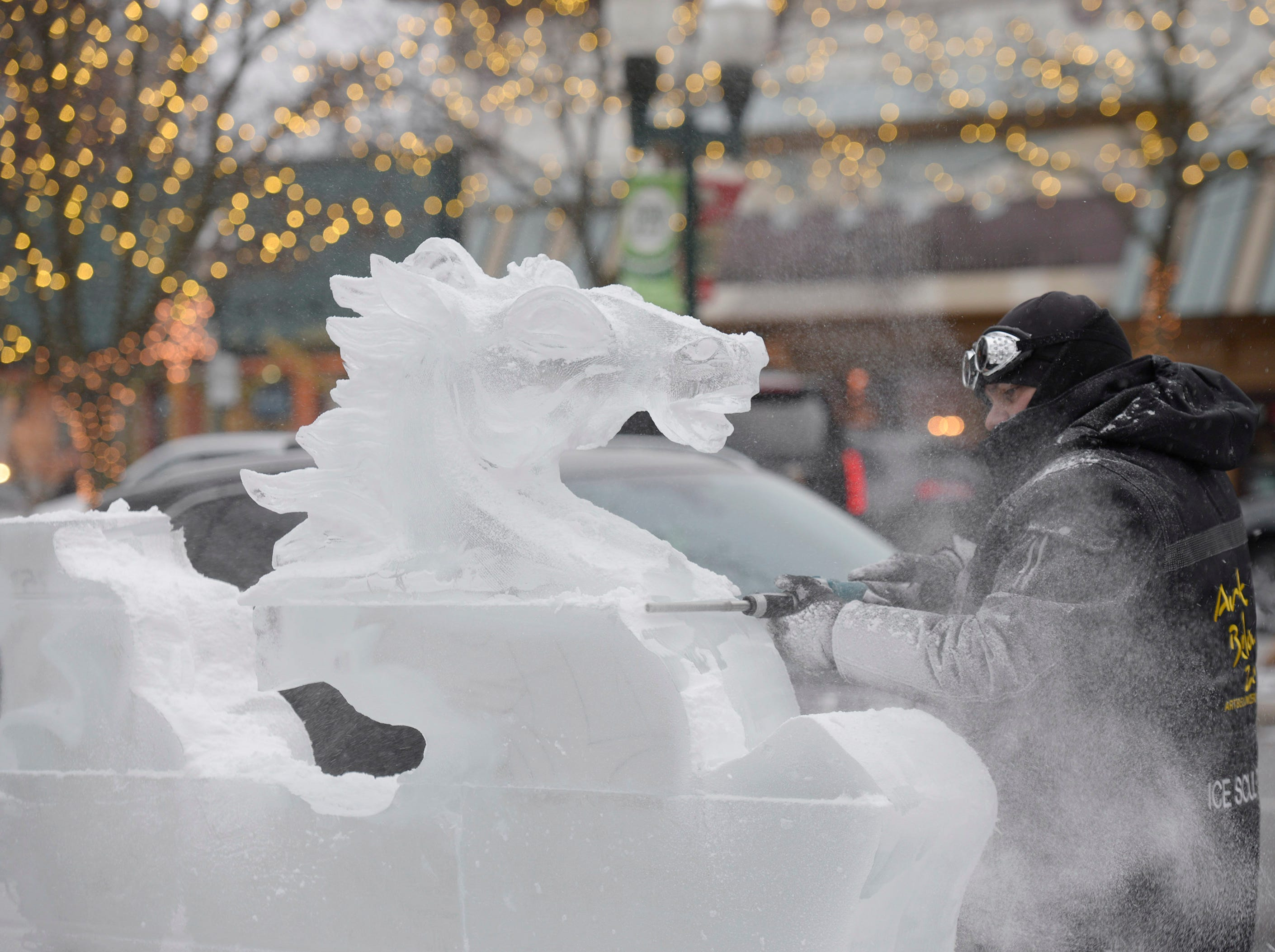 With the head carved by Aaron Costic now on more blocks of ice, Max Zuleta from Elegant Ice Creations continues to the carve a sculpture that will use 14 blocks of ice when it is all done.