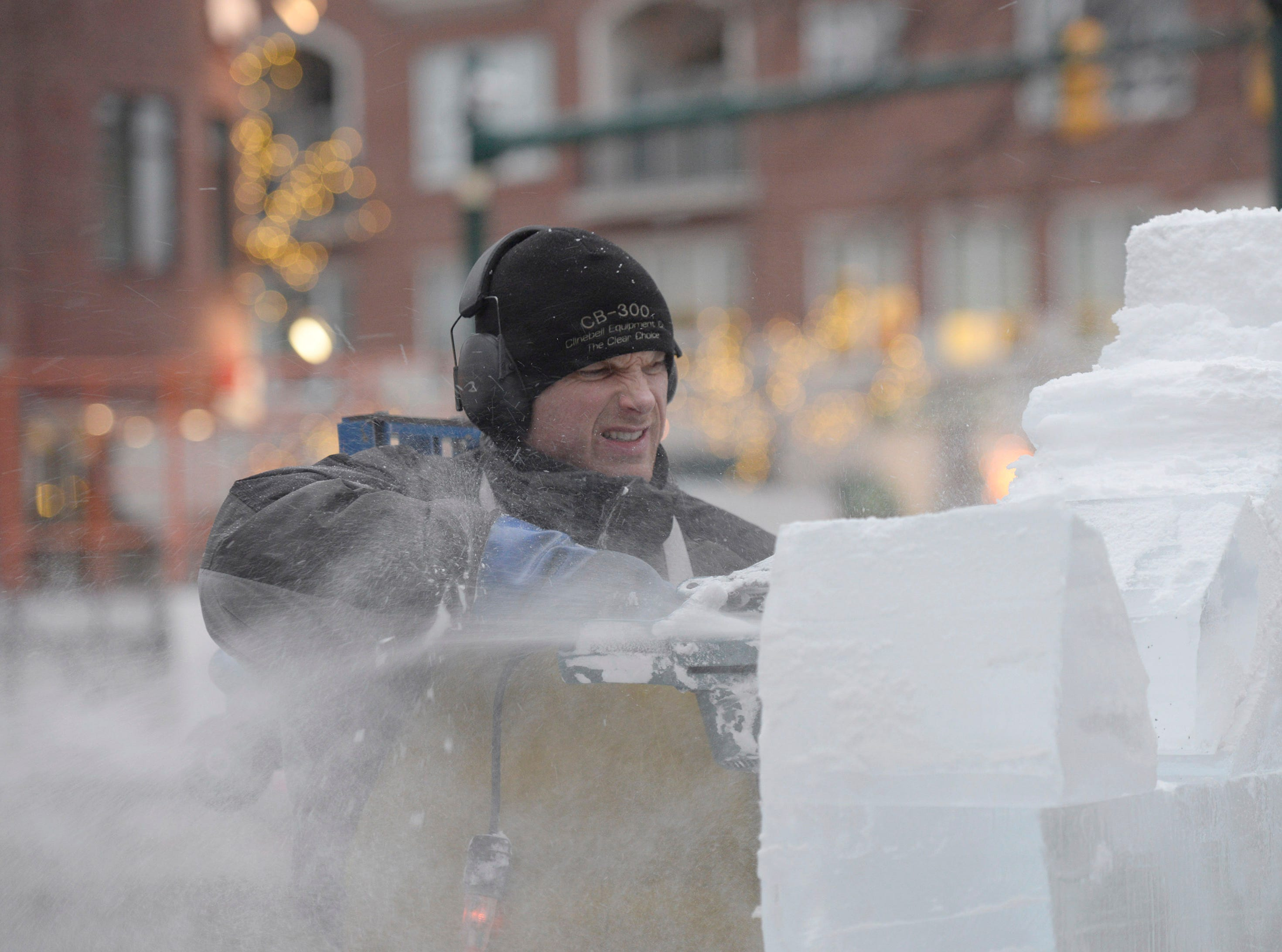 Clinton Rich works on a piece for the for the Plymouth Ice Festival that runs Jan. 11-13.