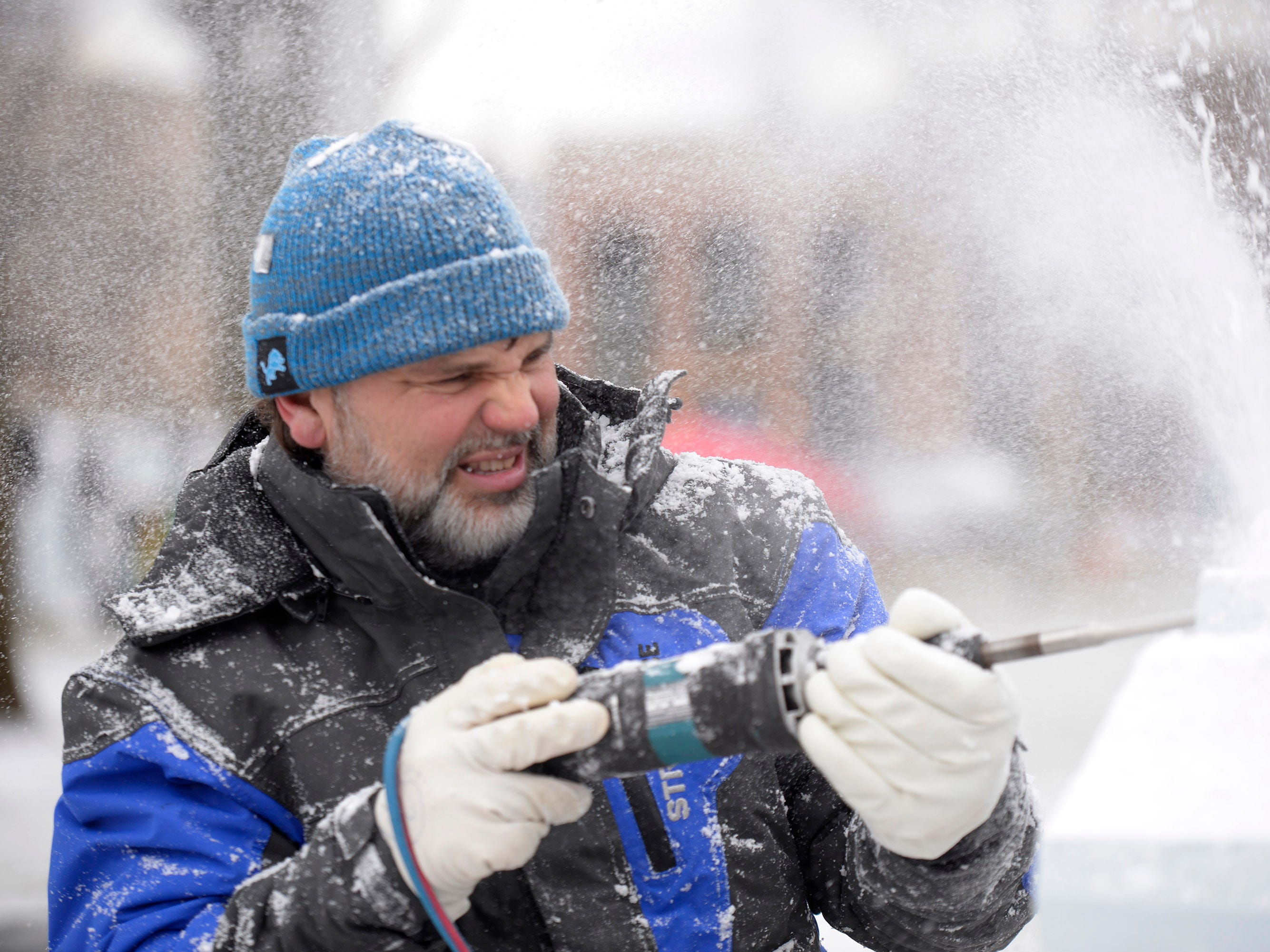 Aaron Costic carves a block of ice preparing for the Plymouth Ice Festival that runs Jan. 11-13.