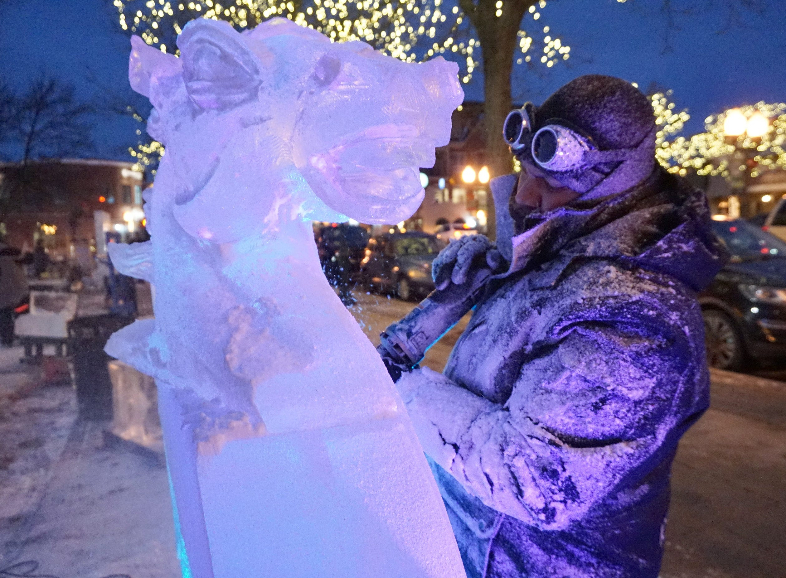 Max Zuleta works on the main feature by Elegant Ice for the Plymouth Ice Festival that runs Jan. 11-13.