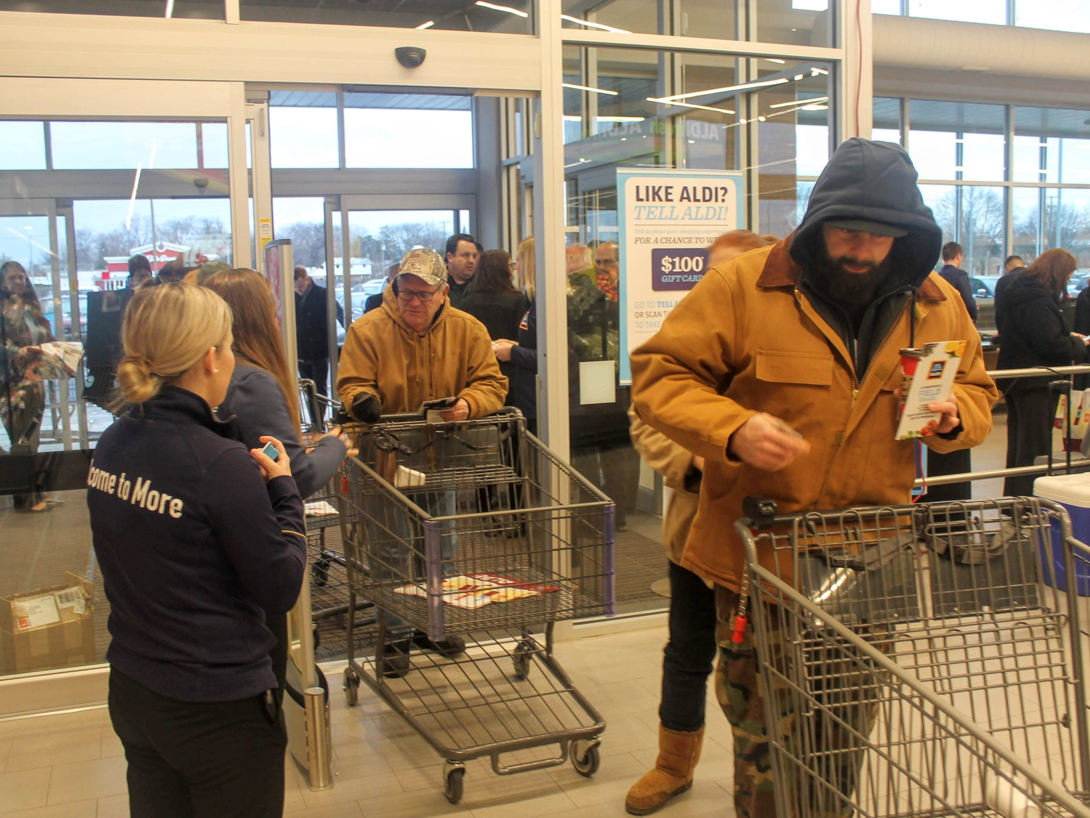 Shoppers begin to enter the store.