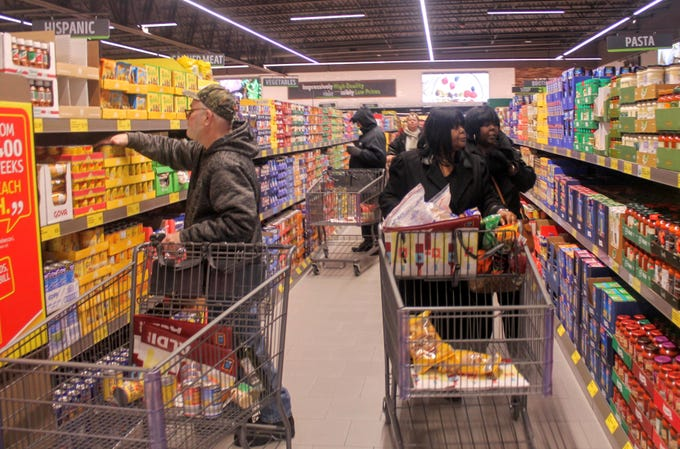 Shoppers fill their carts.
