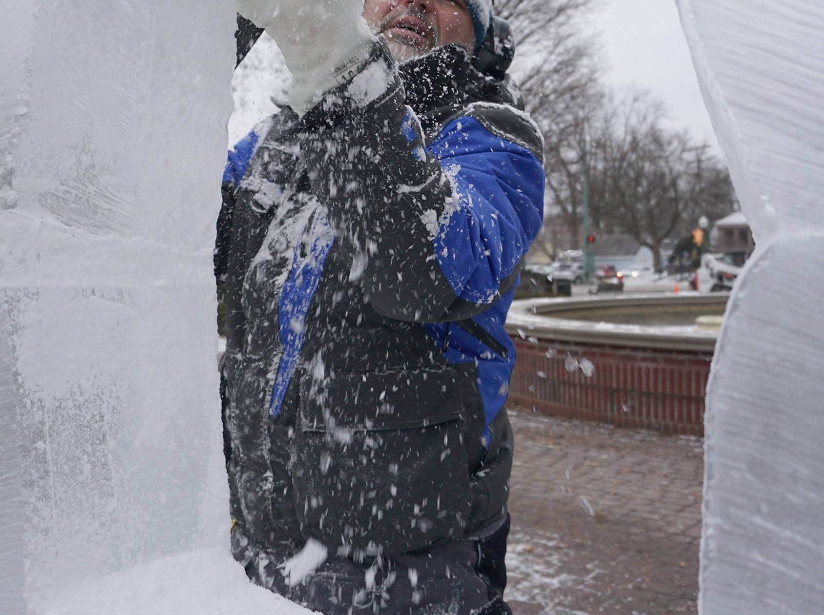 Aaron Costick carves a sculpture that will become a photo frame for guests at the Plymouth Ice Festival that runs Jan. 11-13.
