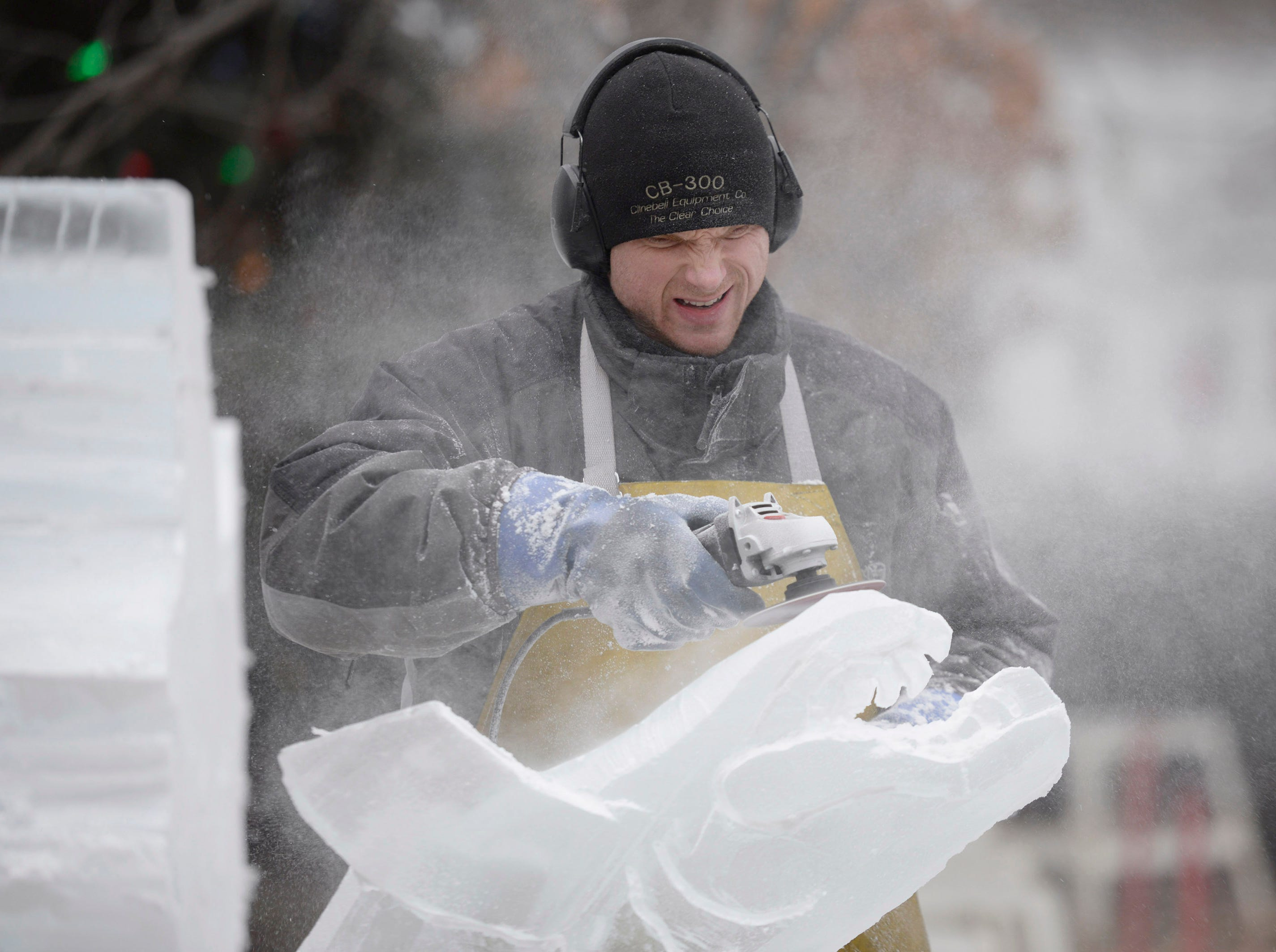 Clinton Rich carves the head of a fish that will be moved onto the blocks behind him Jan. 9 preparing for the Plymouth Ice Festival that runs Jan. 11-13.