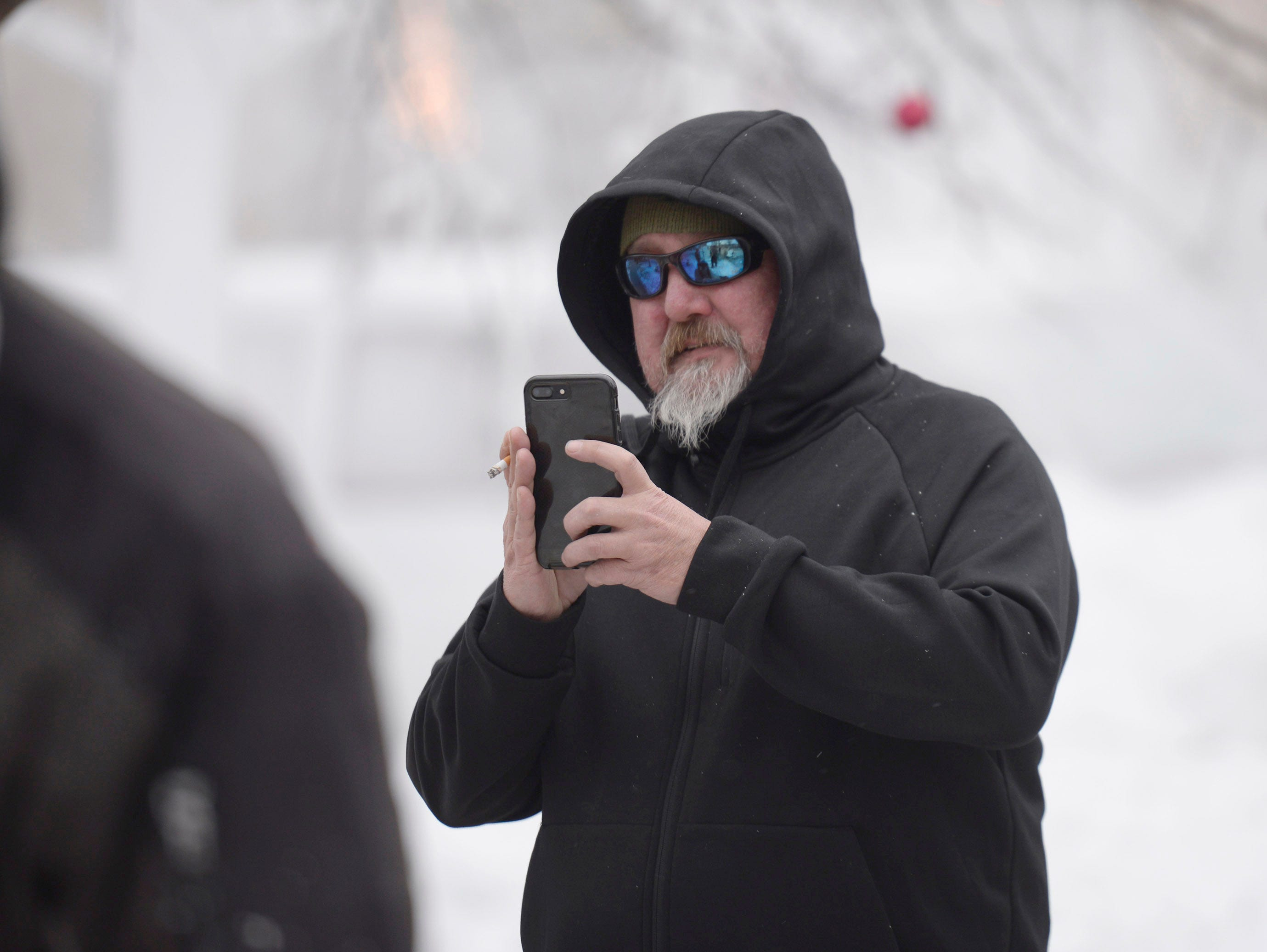 Eric Wollgast takes photos of crews carving ice at the Plymouth Ice Festival that runs Jan. 11-13.
