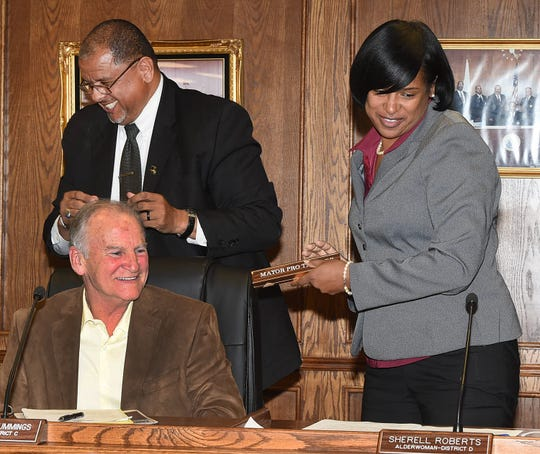 Sherell Roberts is presented her nameplate from Mayor Julius Alsandor designating her as mayor pro tempore. Also pictured at Tuesday's City Council meeting is Alderman Charles Cummings.