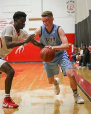 Rancho Mirage's Grant Kelly dribbles against Palm Springs' Damien King on Wednesday night.