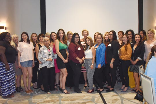 The Girl Friend Factor Recipient Relations Committee introduce the Scholarship Recipients to the luncheon Guests